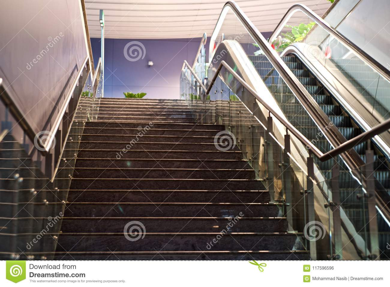 Download Stylish Stairs And A Escalator Lift Of A Shopping Mall Unique Photo Stock Photo - Image of mall, abstract: 117596596