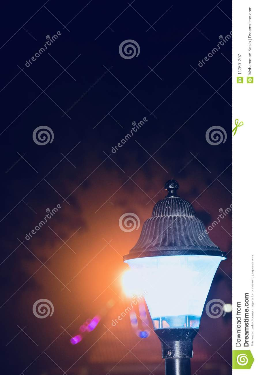Download A Stylish Street Lamps At Night Unique Photo Stock Image - Image of night, photograph: 117591207