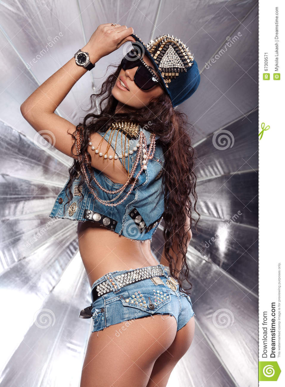 stylish swag girl in cap. beautiful ass. in jeans shorts stock image