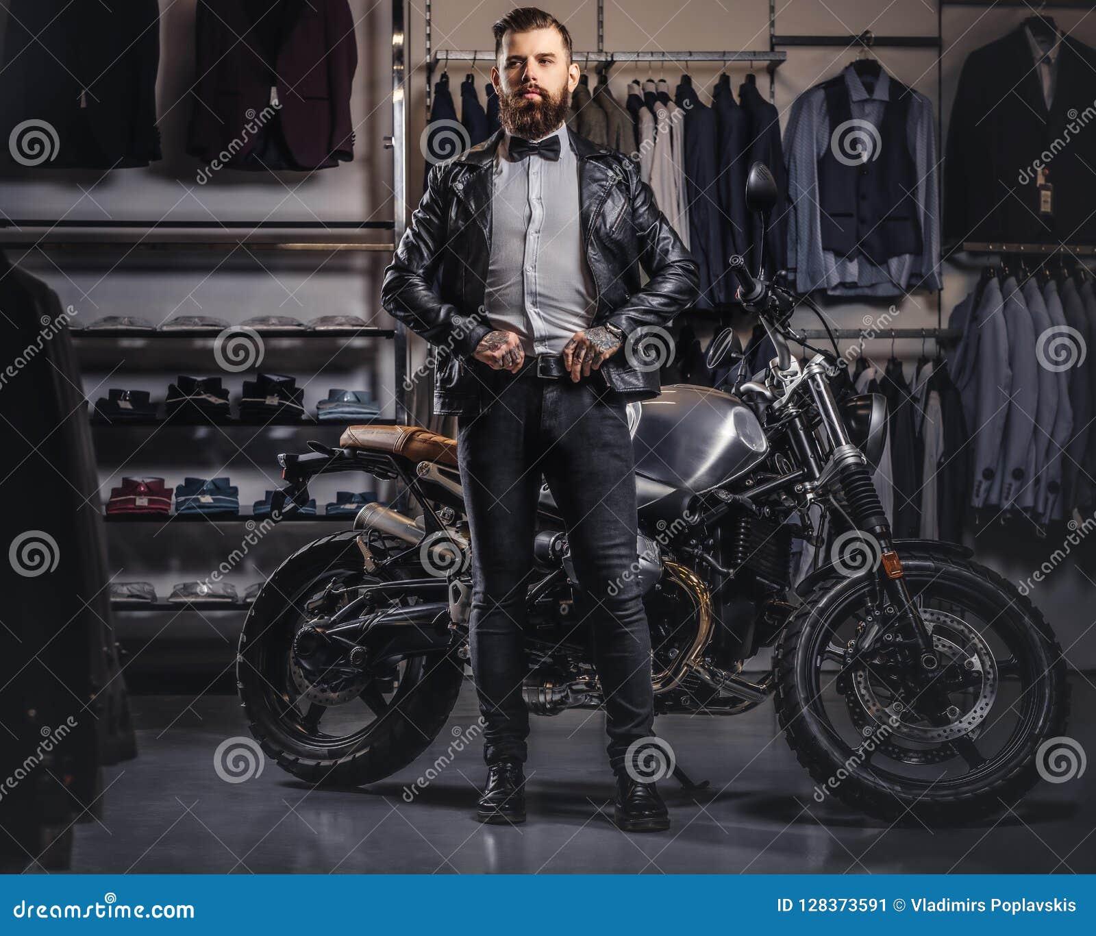 Stylish Tattooed Bearded Man With Dressed In Black Leather Jacket