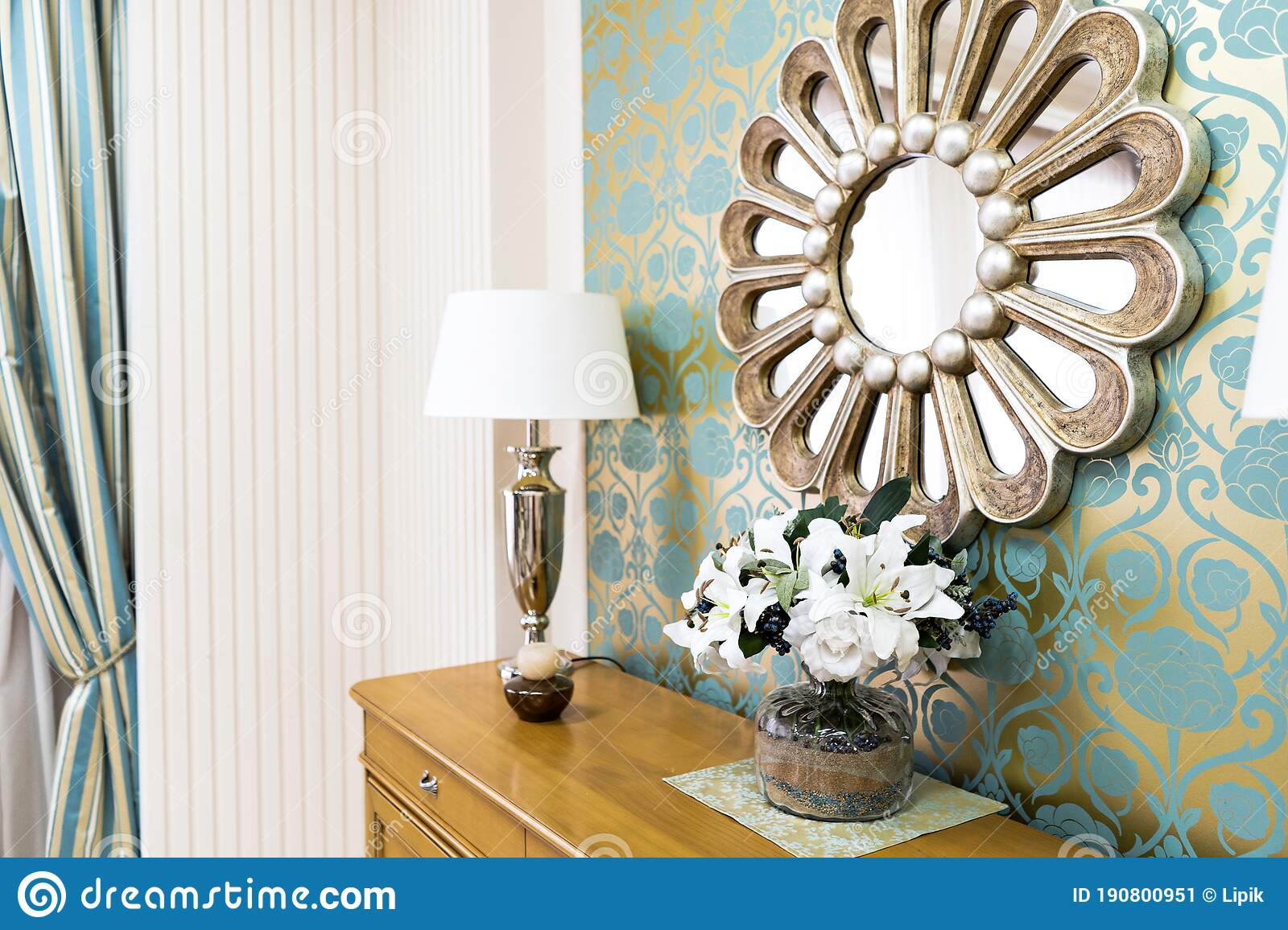 Stylish Vintage Style Home Interior With Wooden Commode And Decorated Round Mirror Symmetrical Reading Lamps On Commode Stock Image Image Of Wainscoting Orange 190800951