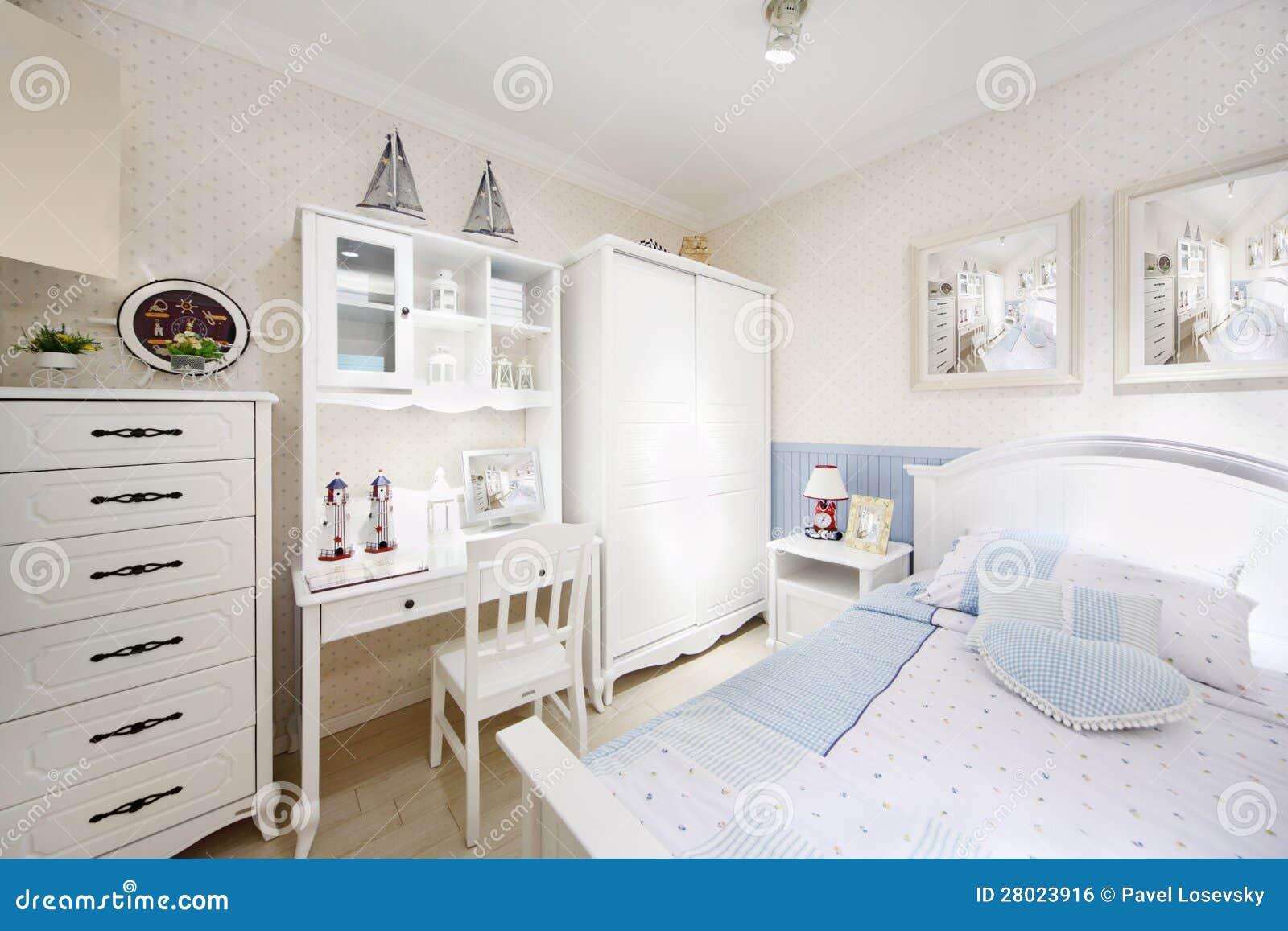 Stylish white bedroom with big bed, wardrobe