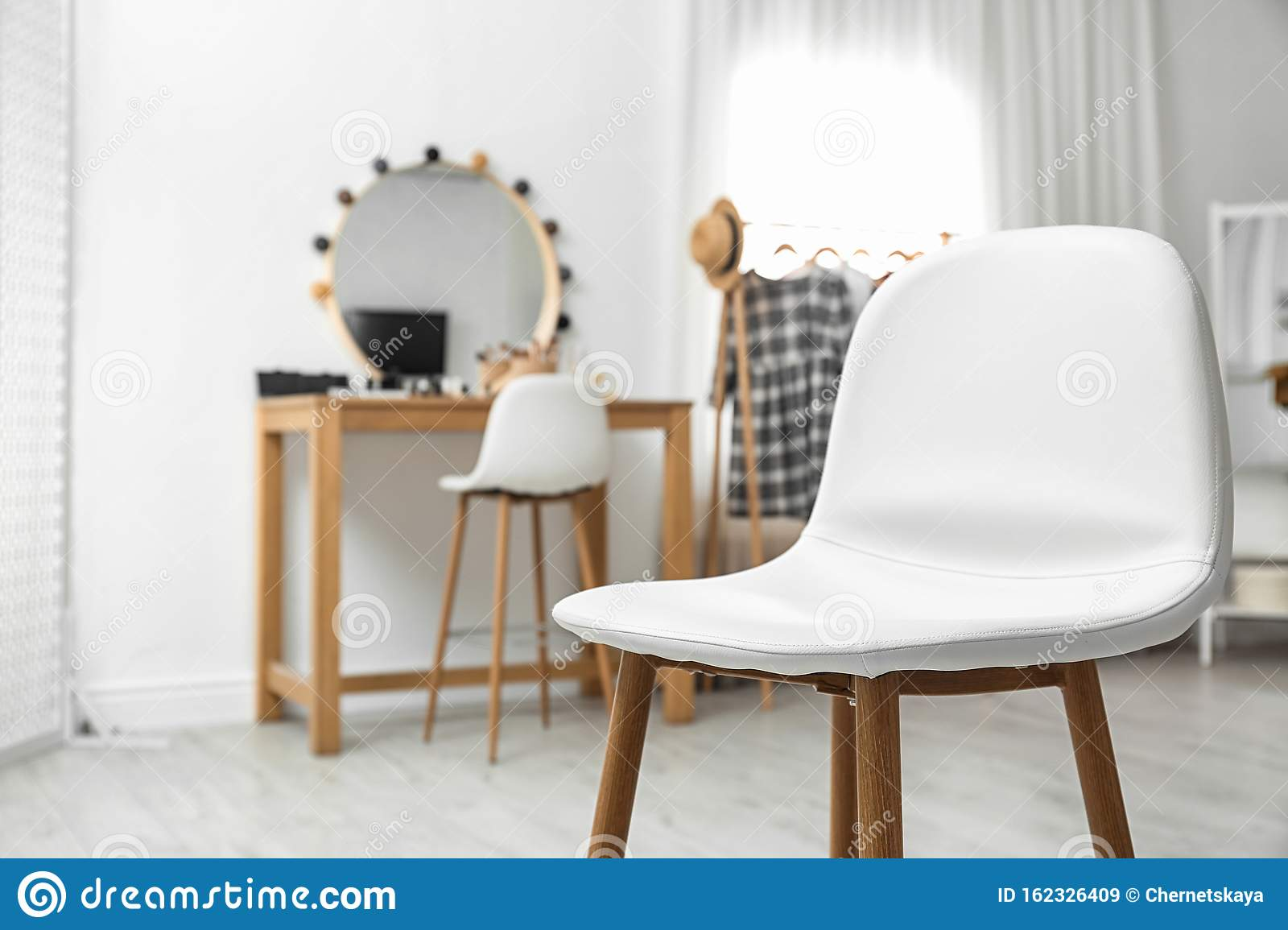Stylish White Chair In Makeup Room Interior Stock Image - Image of