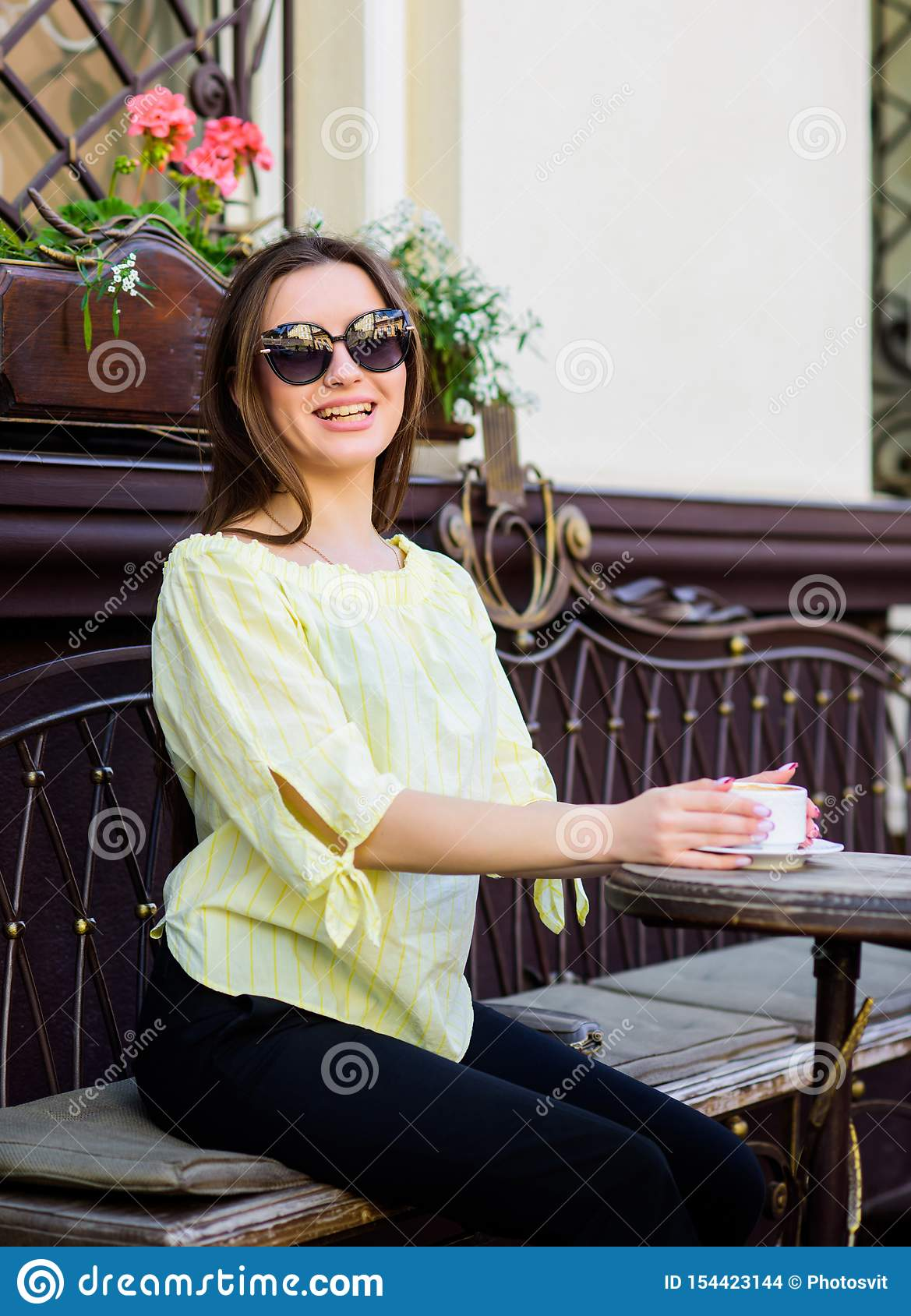 Stylish woman in glasses drink coffee. girl relax in cafe. Business lunch. summer fashion beauty. Meeting in cafe. good
