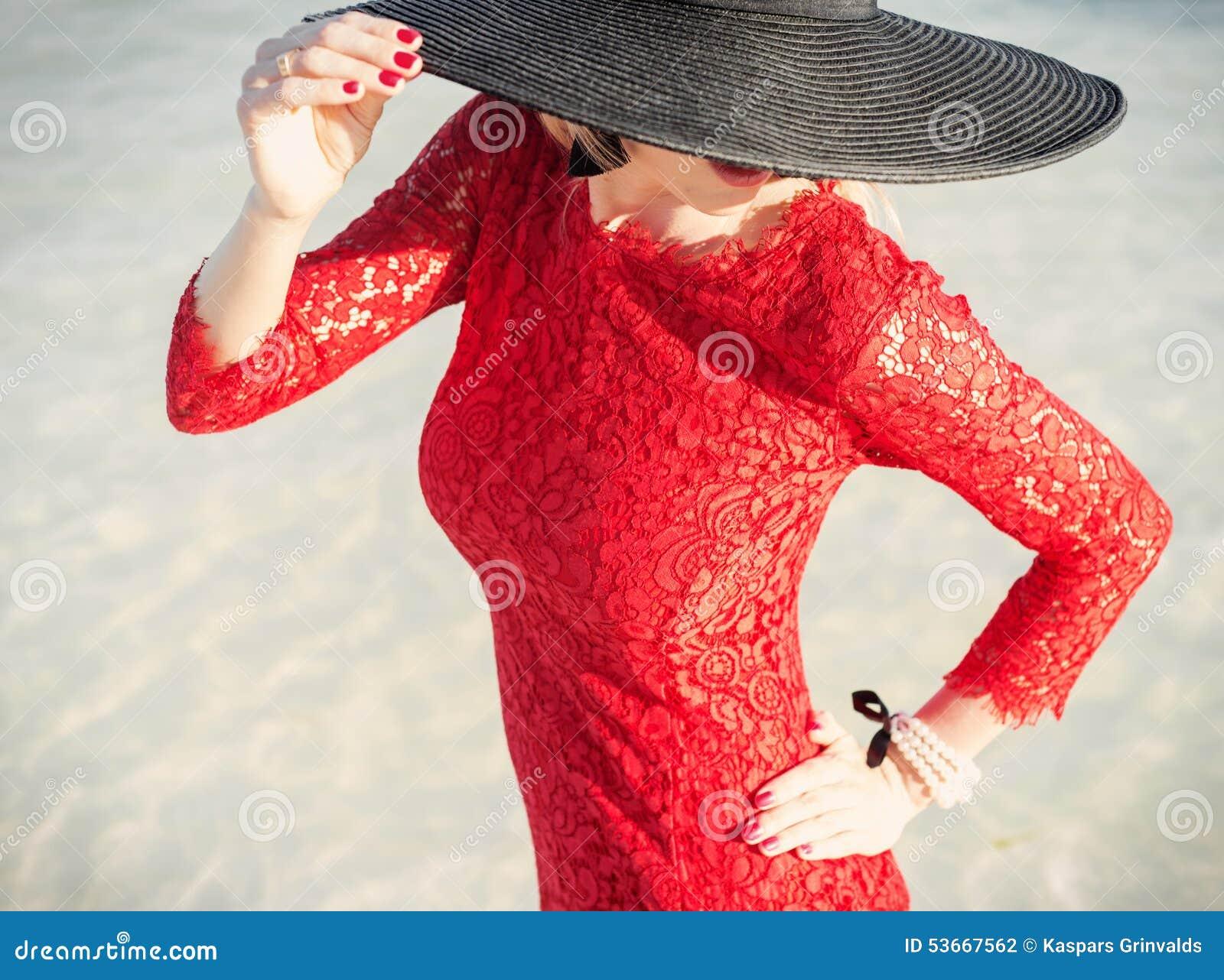 Stylish Woman Wearing Red Dress And Black Hat Stock Photo - Image of ... 439474b5236