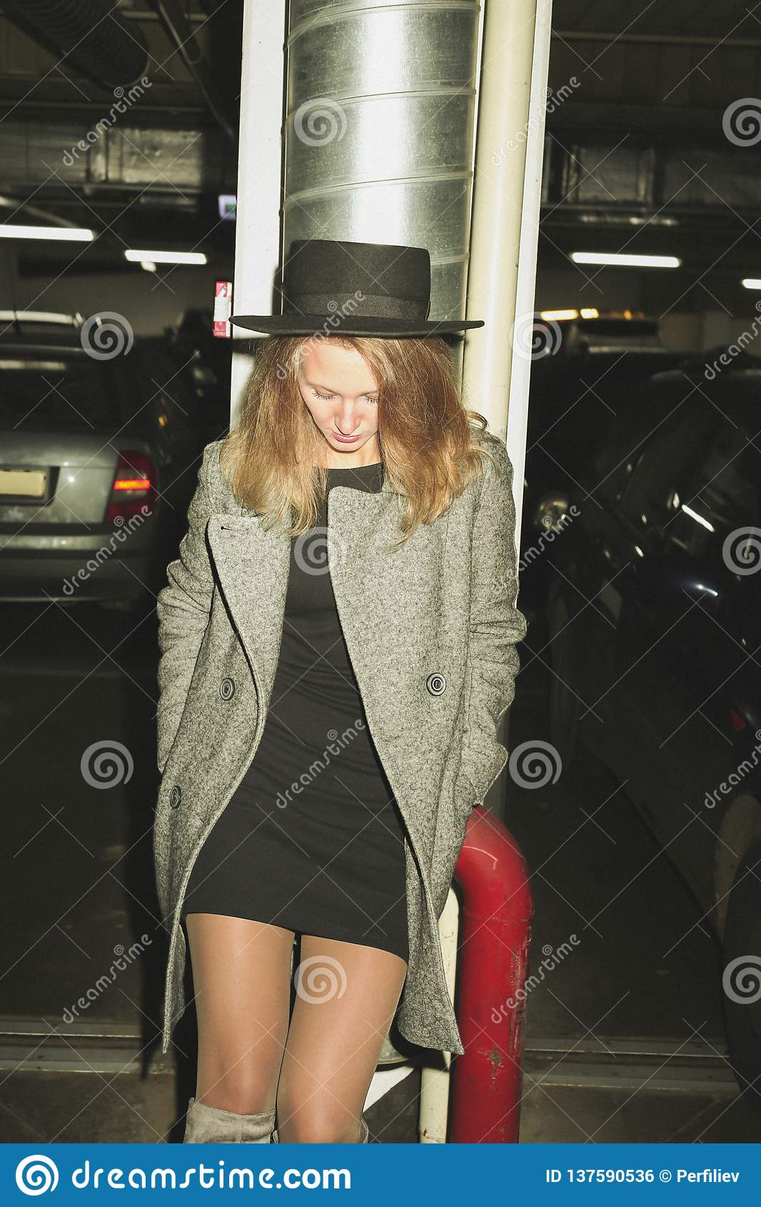 Fashionable woman on parking lot