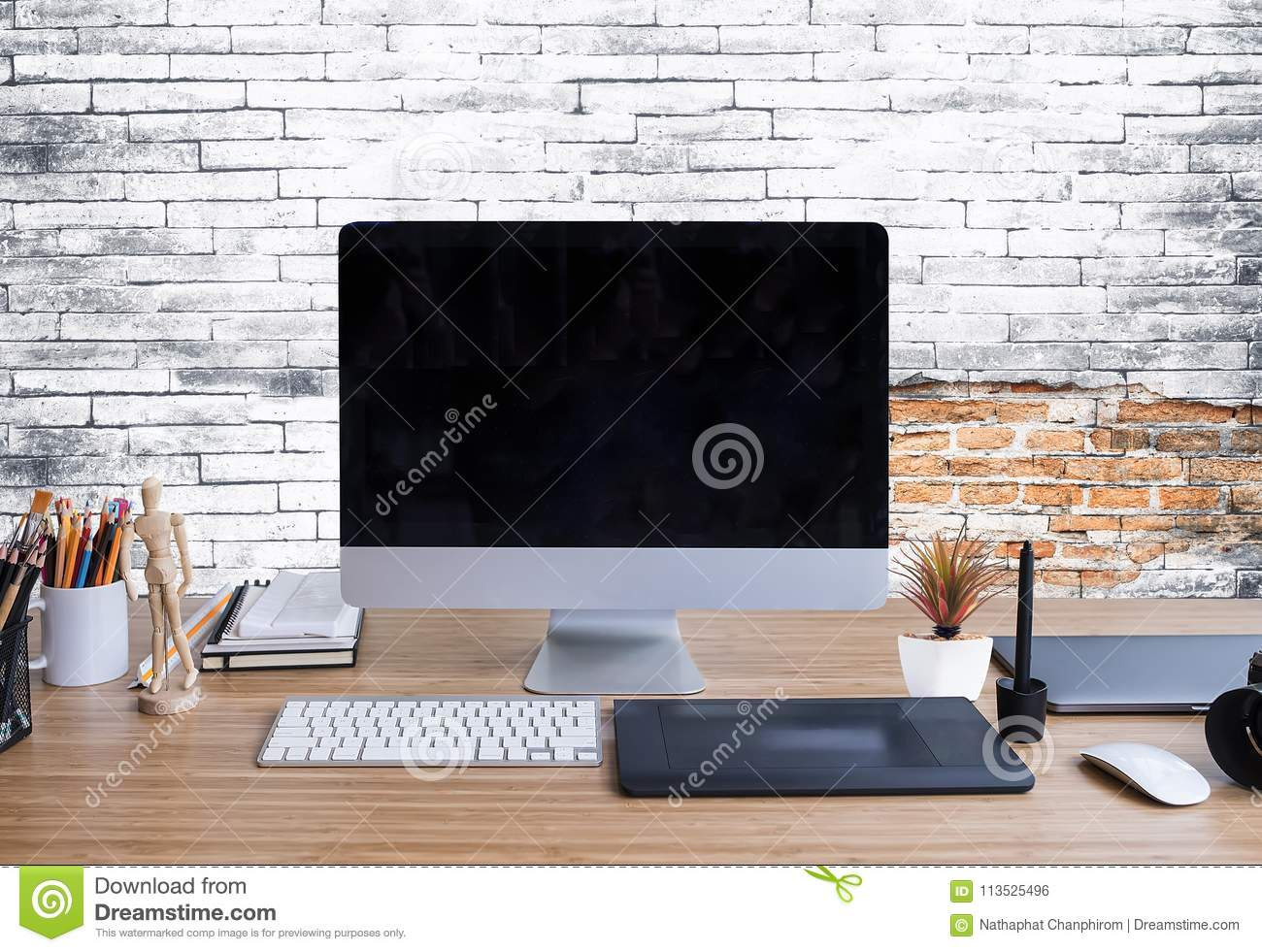 Stylish Workspace With Desktop Computer, Office Supplies And Lap