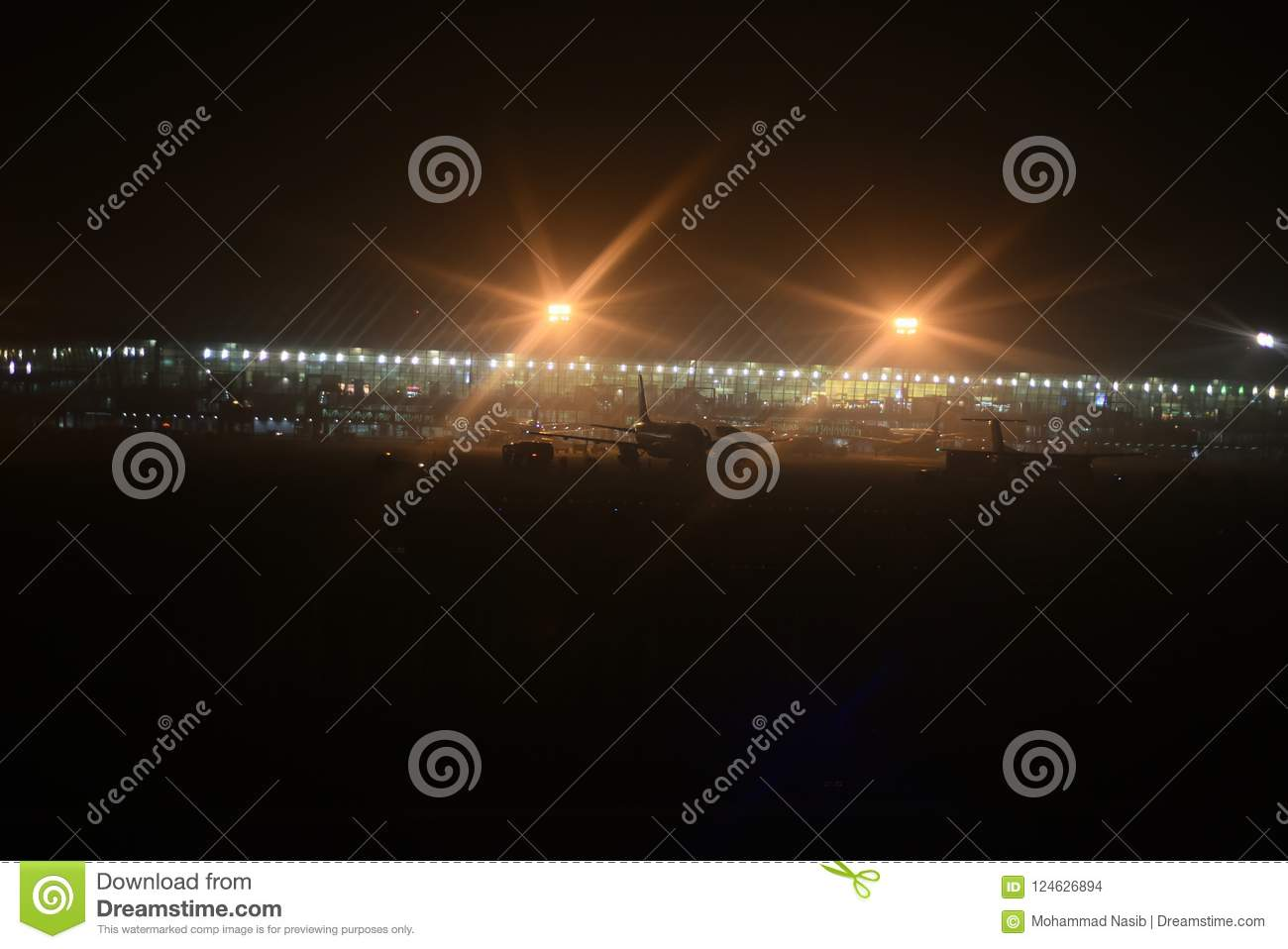 Download Beautiful Blurry Exterior Lights Of An Airport Unique Photo Stock Photo - Image of aviation, nightscene: 124626894