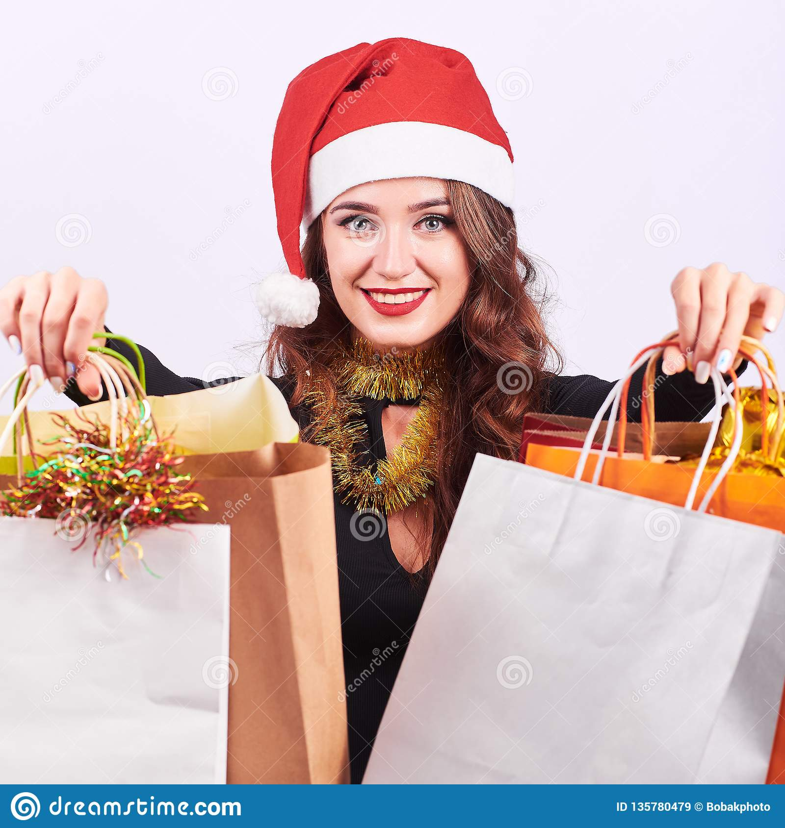0e4d3de7ee115 stylish-young-brunette-woman-colorful-shopping-bags-portrait-young-happy- woman-red-santa-claus-hat-holding-colorful-135780479.jpg