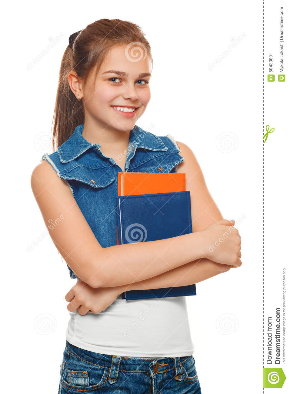 Stylish Young Girl In A Jeans Vest And Denim Shorts With Books In Hands. Schoolgirl With ...