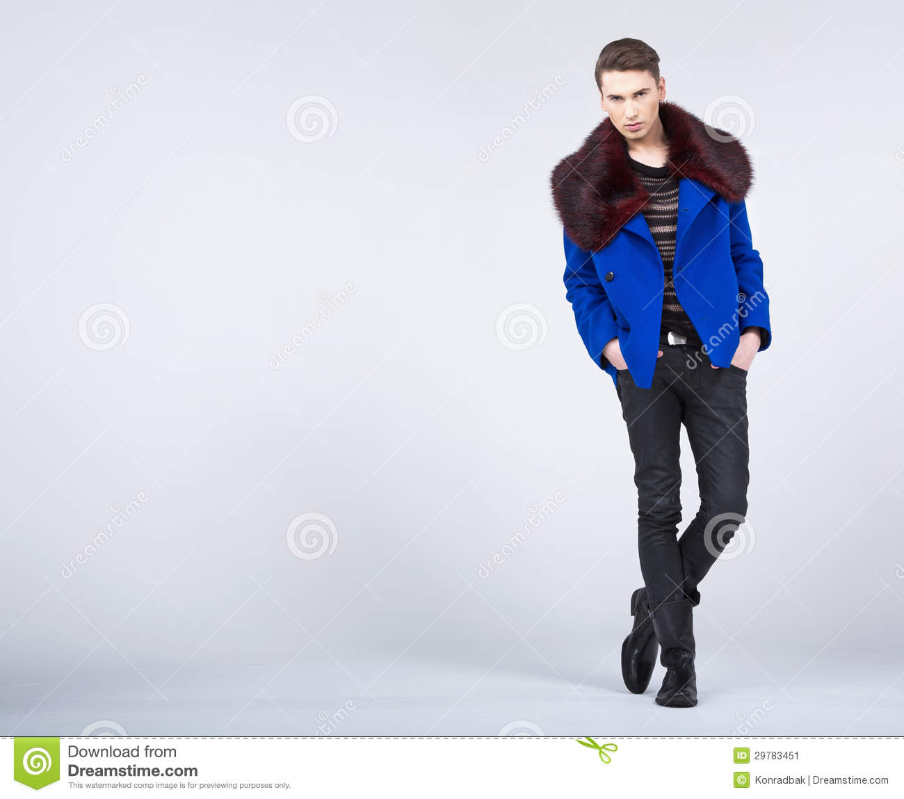 Stylish Young Man In Fashion Pose Stock Image - Image of