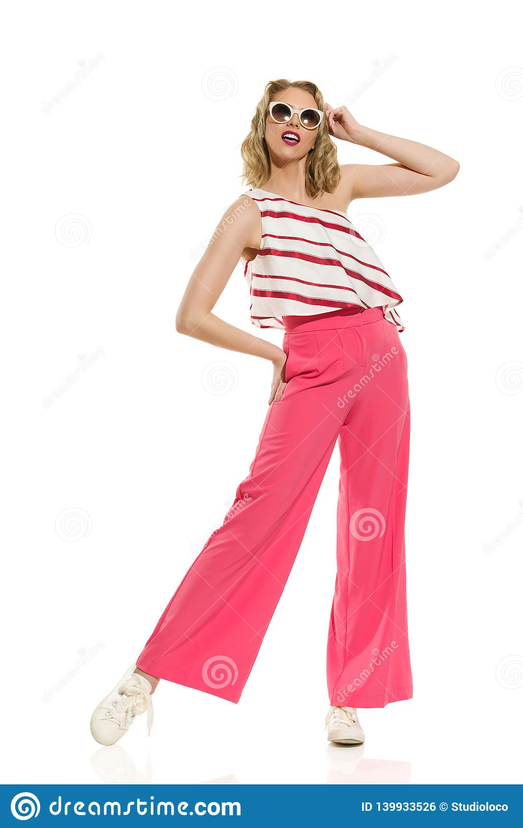 Stylish Young Woman In Red Wide Leg Trousers And Sunglasses
