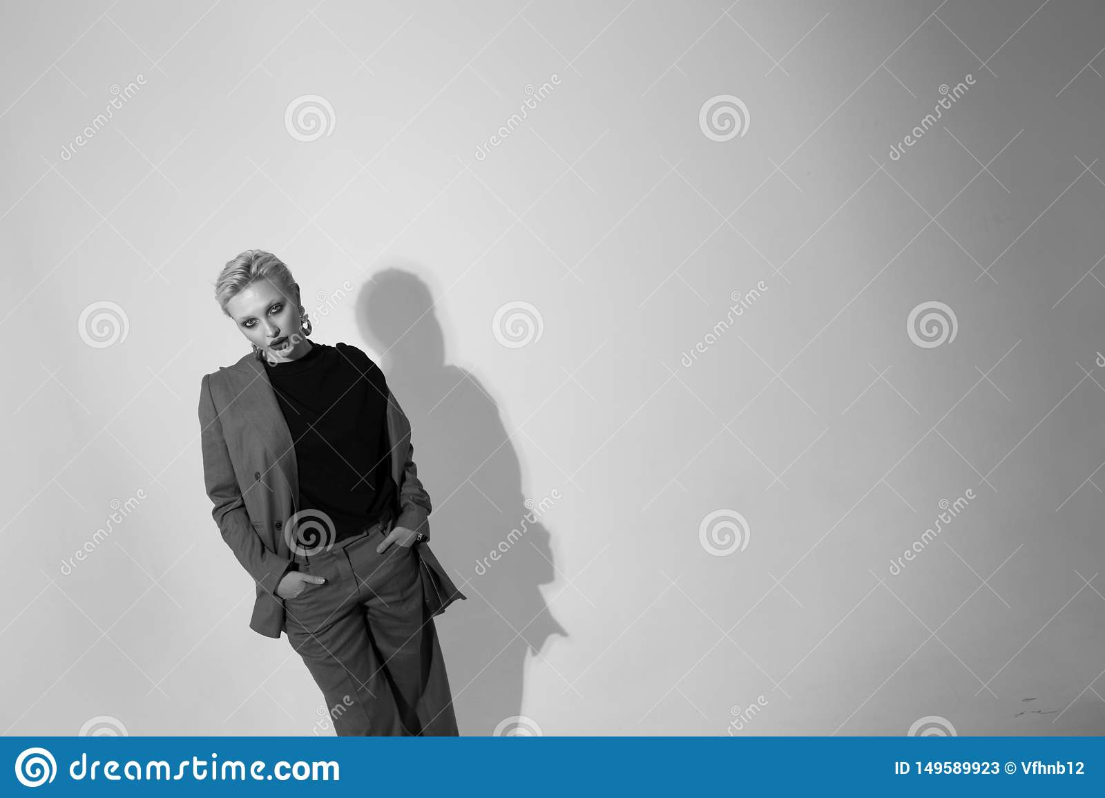 Stylish Young Woman In A Suit In The Studio On A White Background