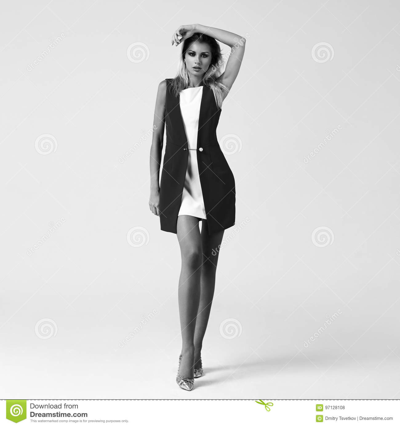 215c9fbb02 Young beautiful stylish woman standing and posing in white short dress and  red jacket on bright gray background. Studio fashion style full length  portrait.