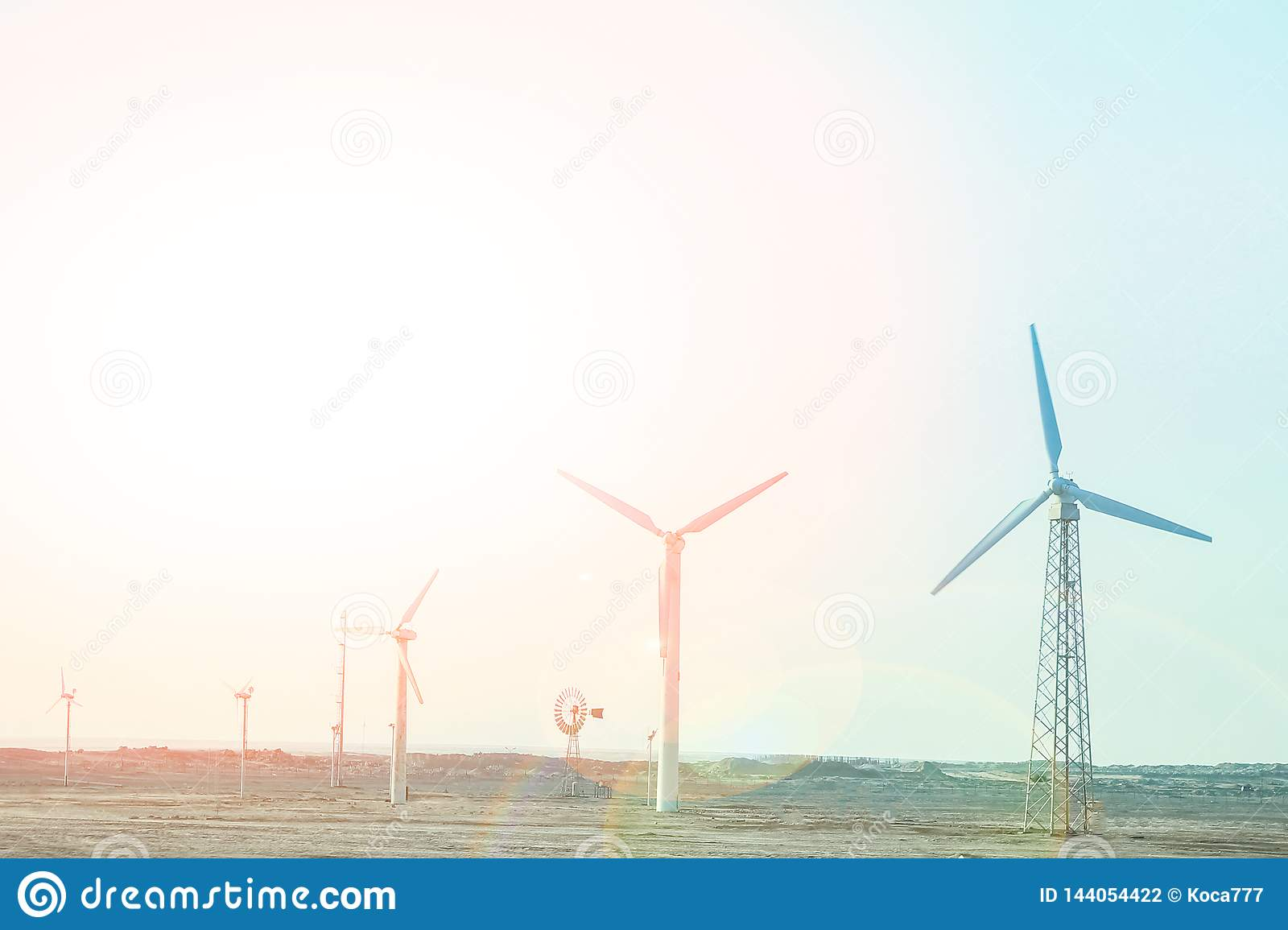 Stylishly practical windmills in the desert background