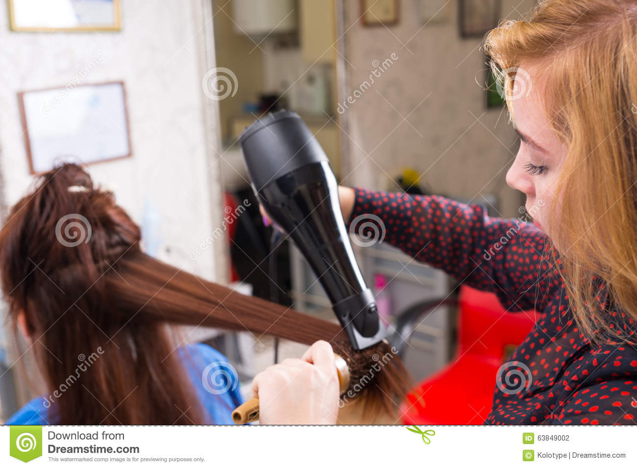 Stylist Using Blow Dryer On Hair Of Client Stock Photo ...