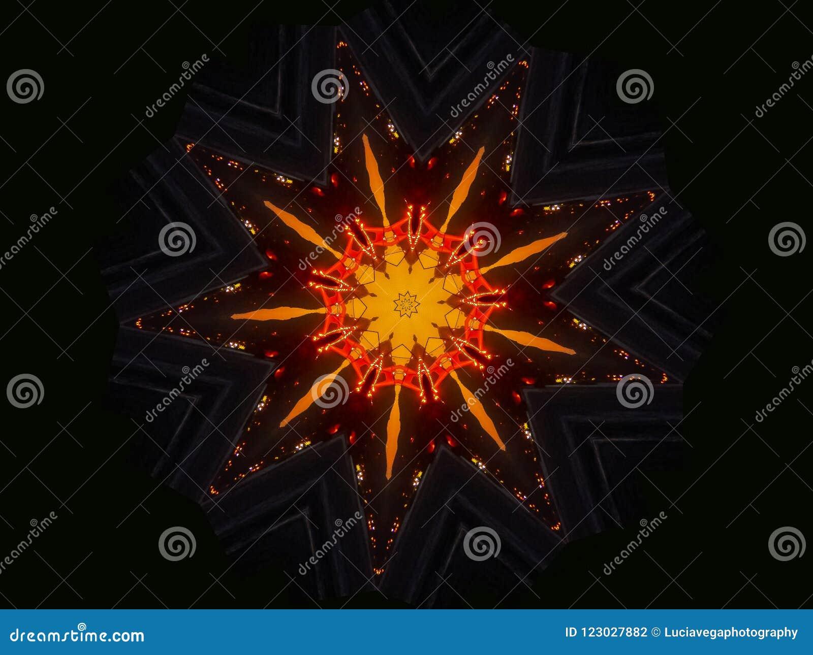 Su mandala anaranjada de la oscuridad de la estrella del exterior soleado