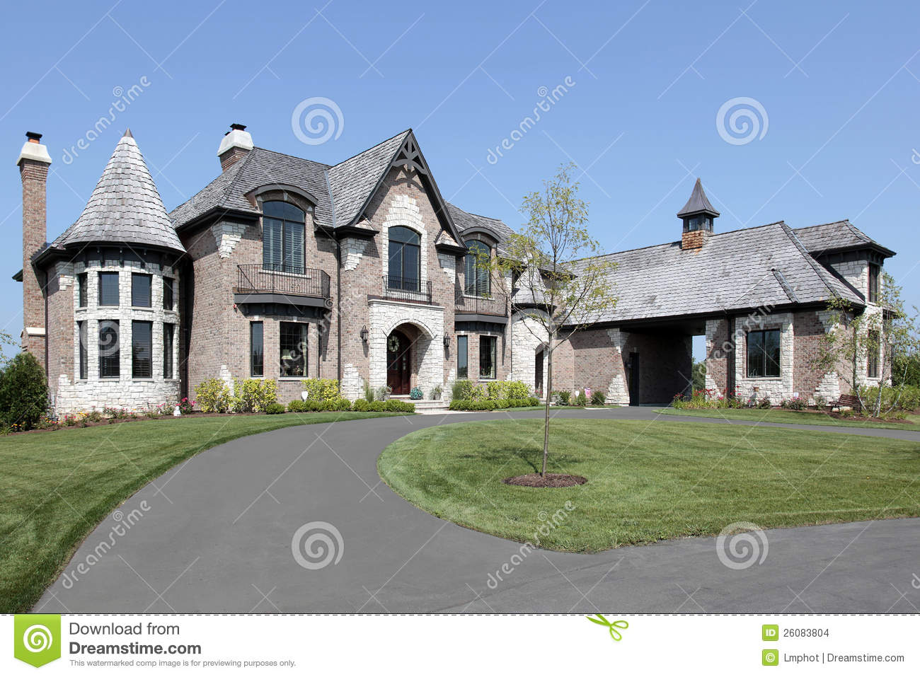 Suburban Brick Home With Circular Driveway Stock Images