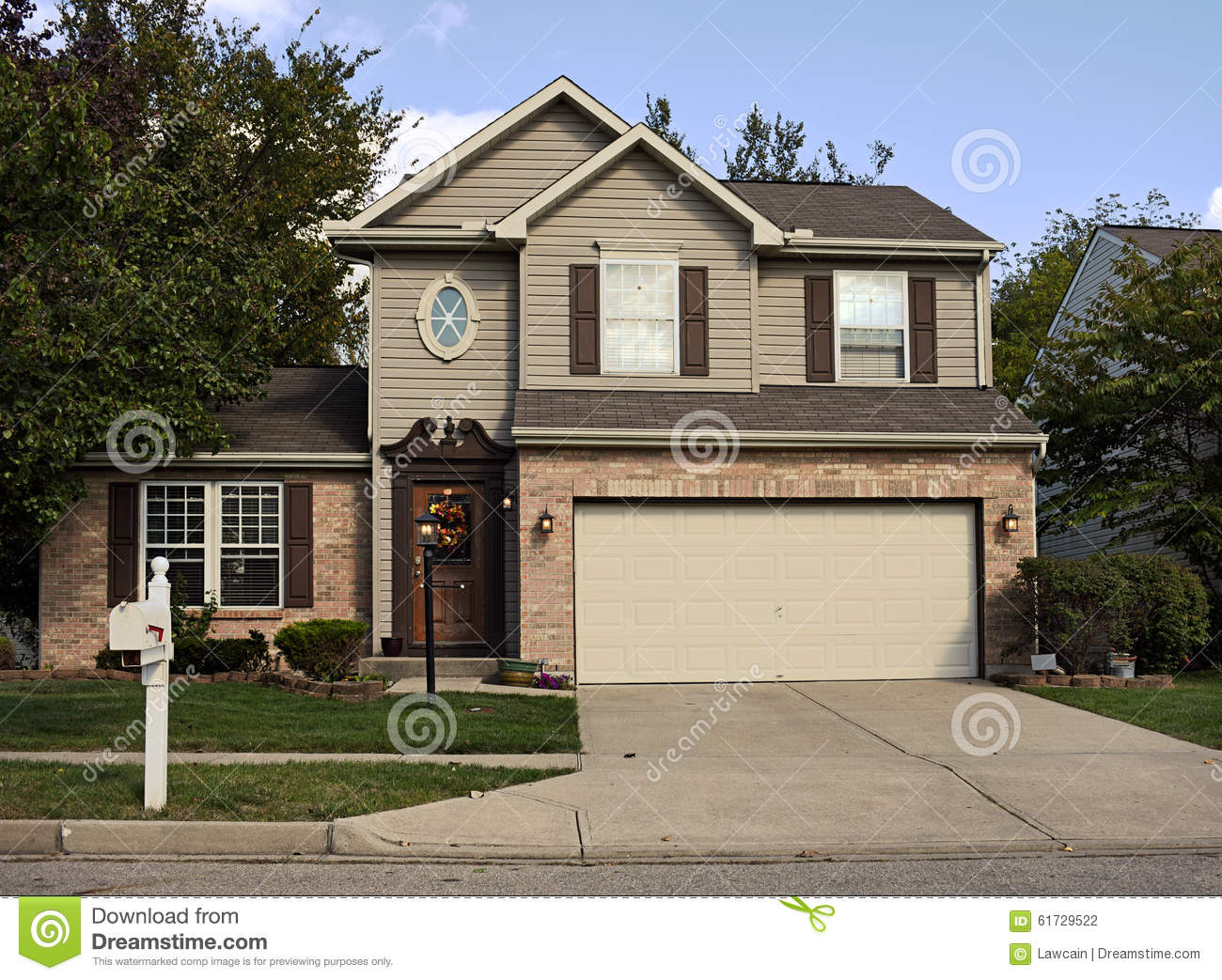 Suburban house with double garage stock photo image of for Brick kit homes