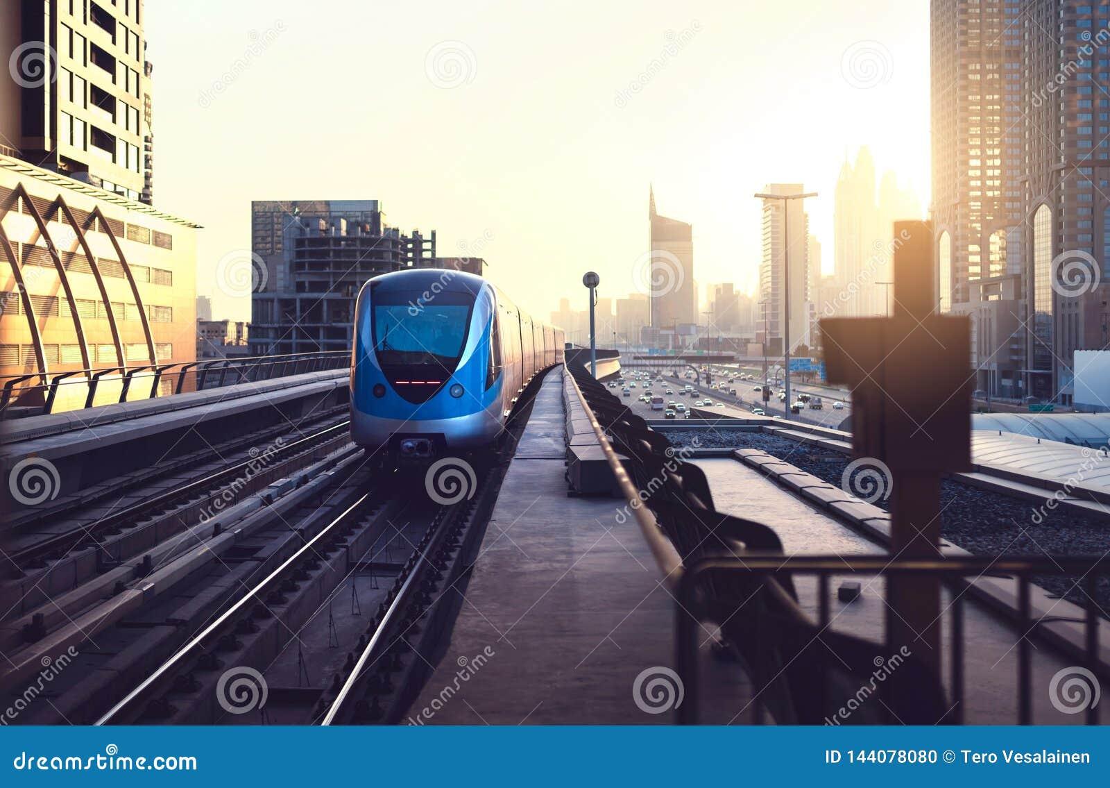 Subway Train At Sunset In Modern City Dubai Metro Downtown