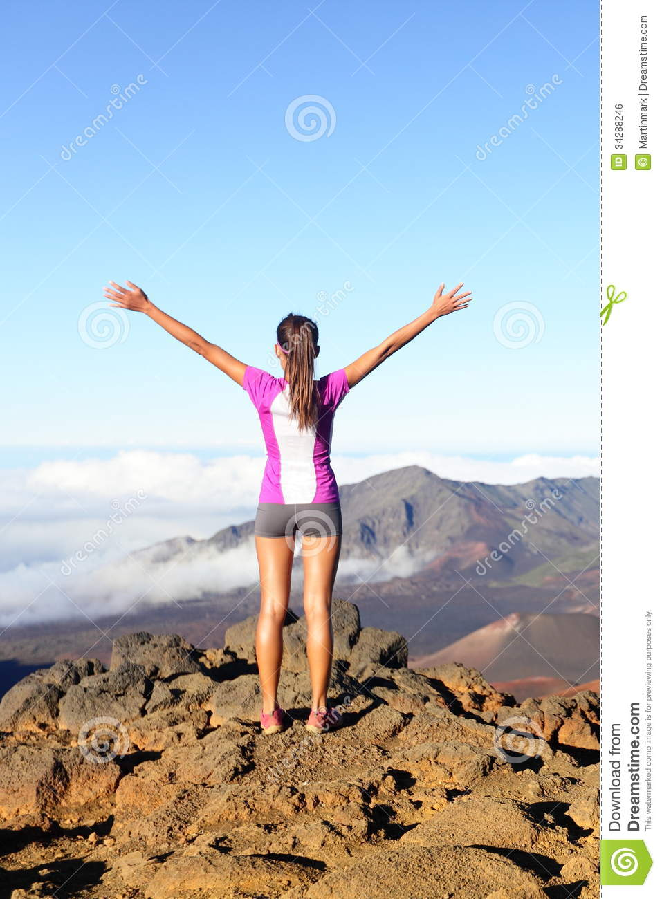 Success and achievement - hiking woman on top
