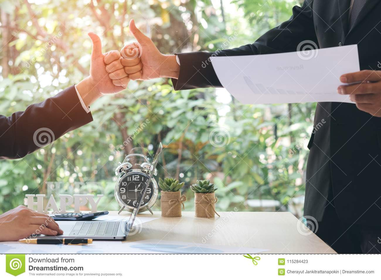 Success businessman partners making fist bump and thump up showing trust in team after achieving goals in office with laptop, doc