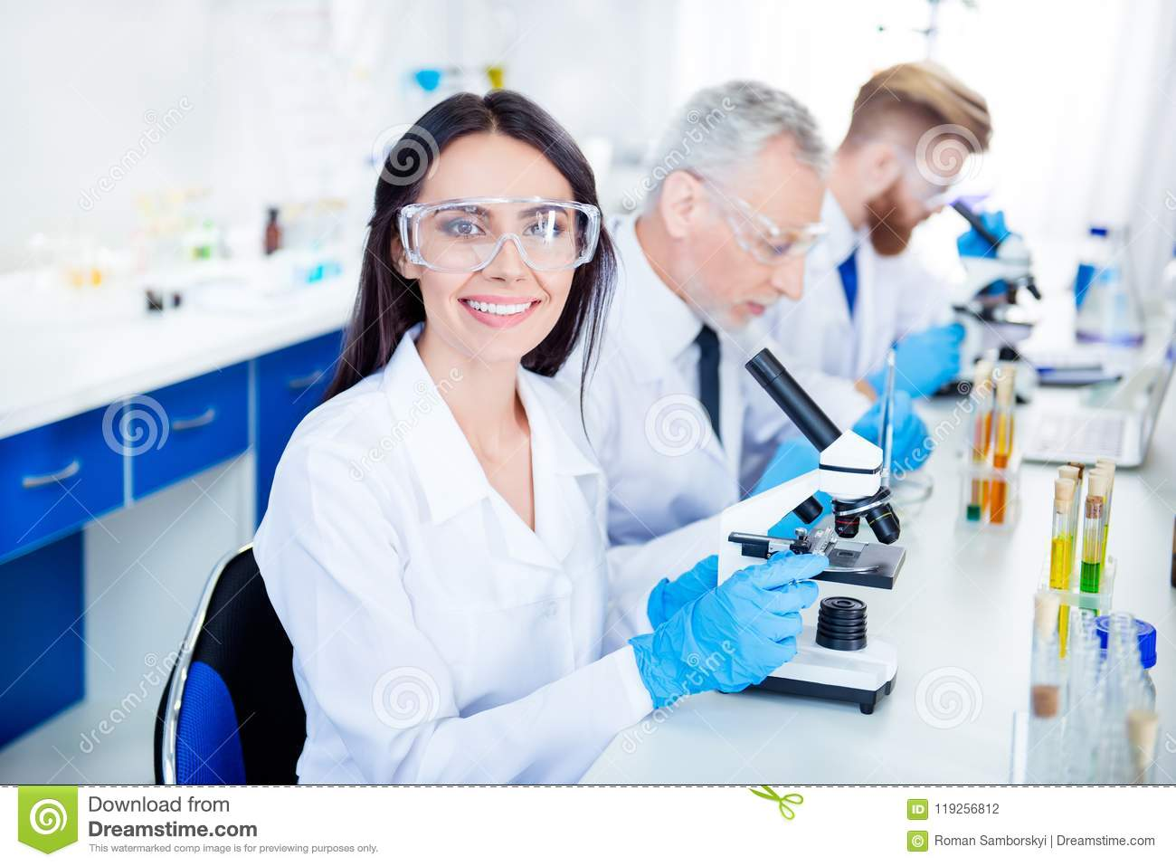 Success in inventing new technology! Young lab worker is smiling