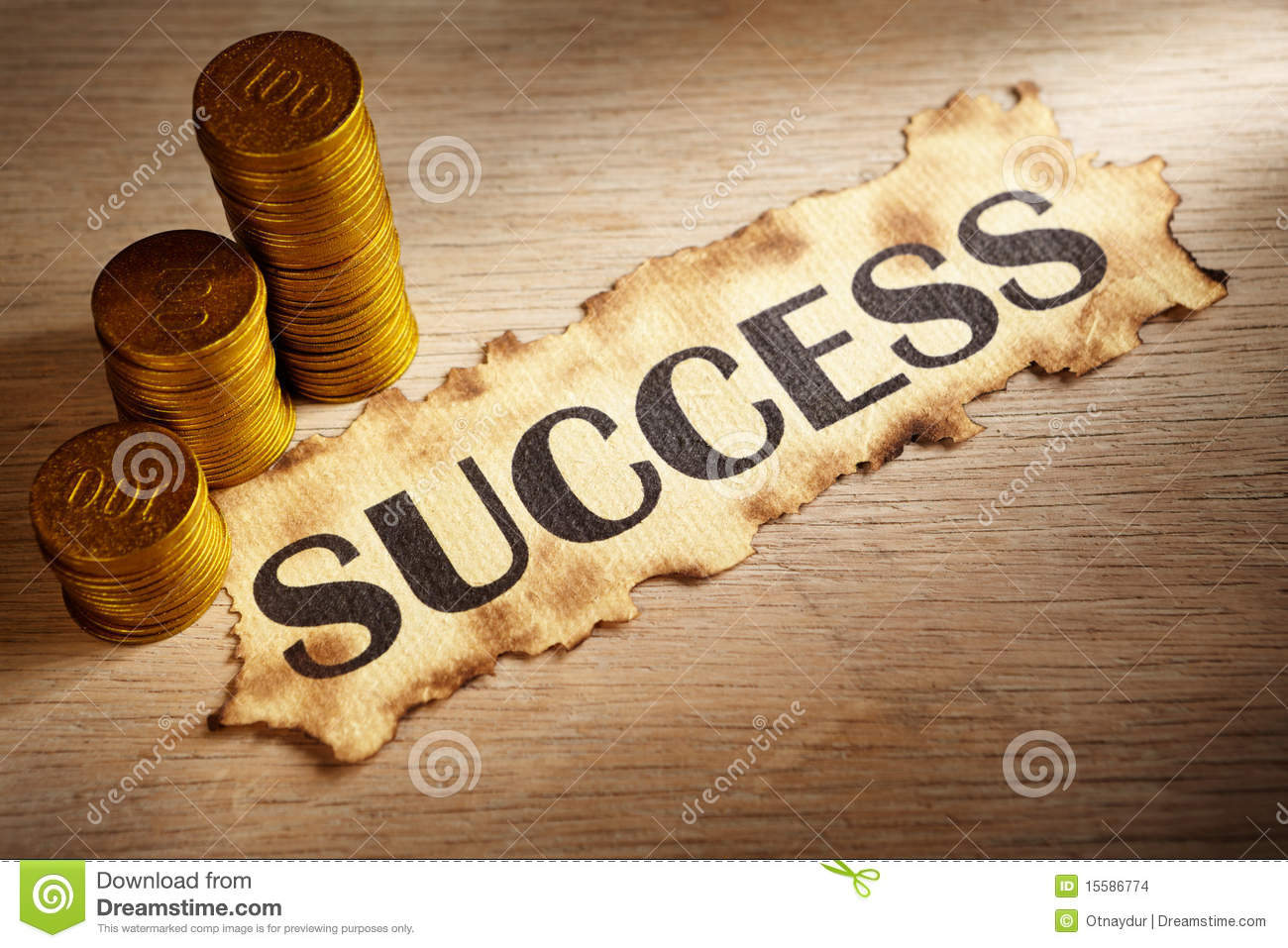 Success written on vintage paper and stack of gold coins.