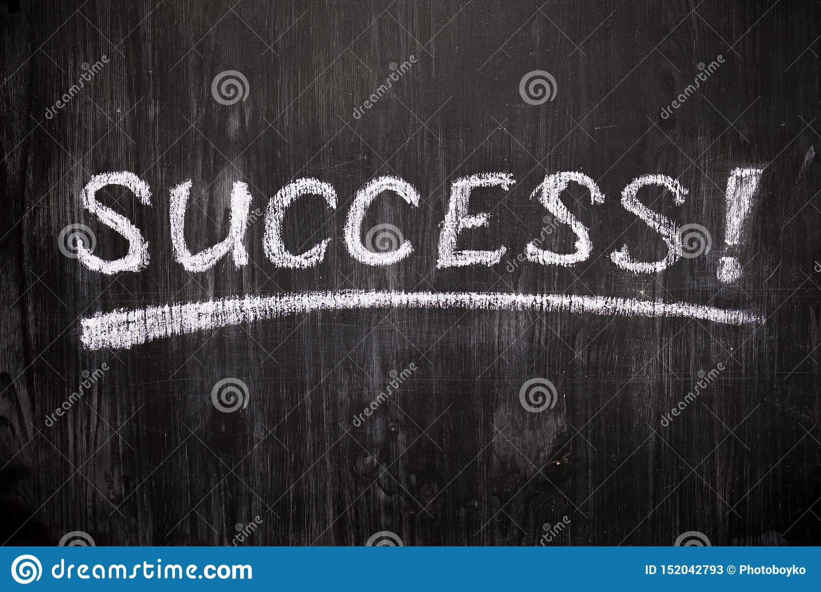 Success sign on black background.