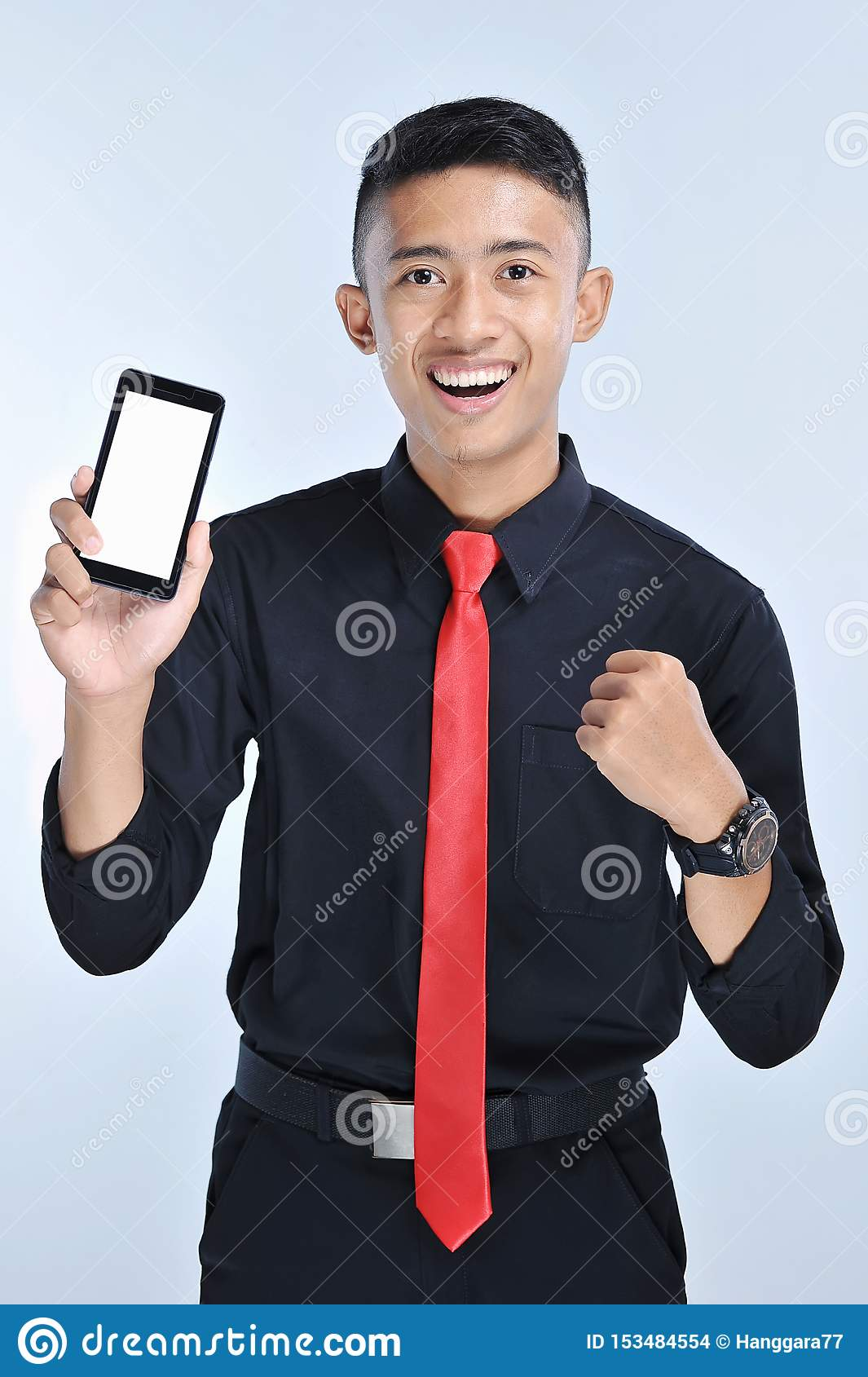 Success winner business man winning on cellphone app. Cheering business man looking at smartphone online gaming challenge or work