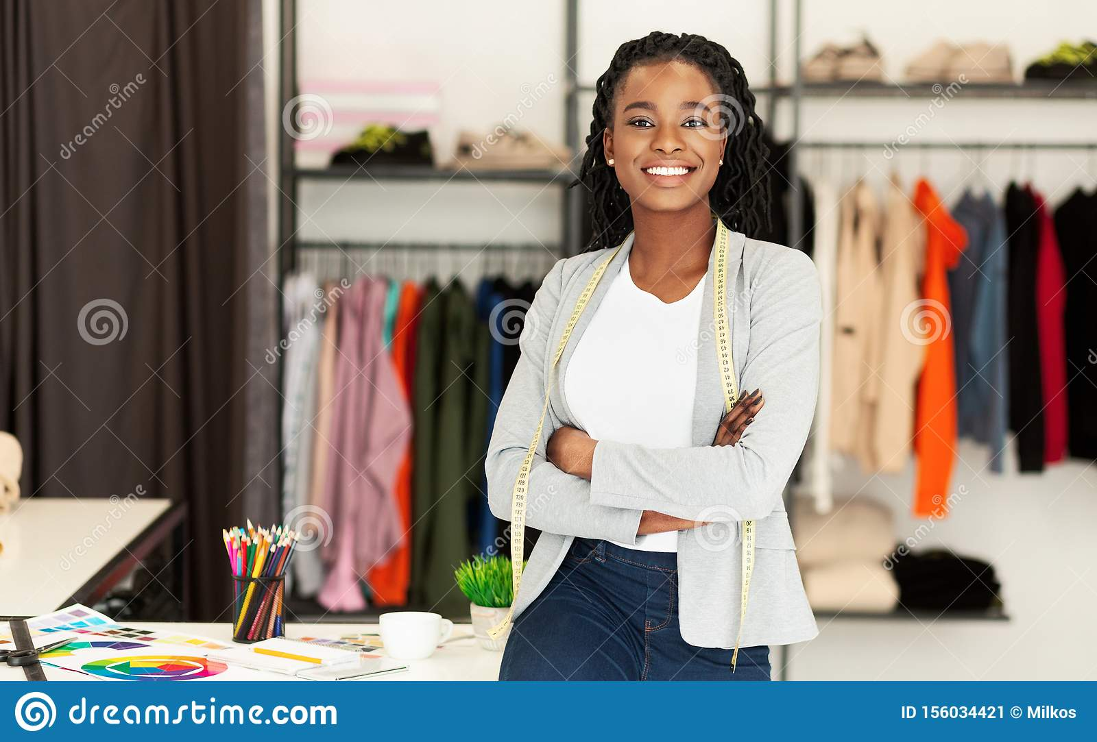 Successful African American Fashion Designer Smiling At Camera In Boutique Stock Image Image Of Indoor Design 156034421