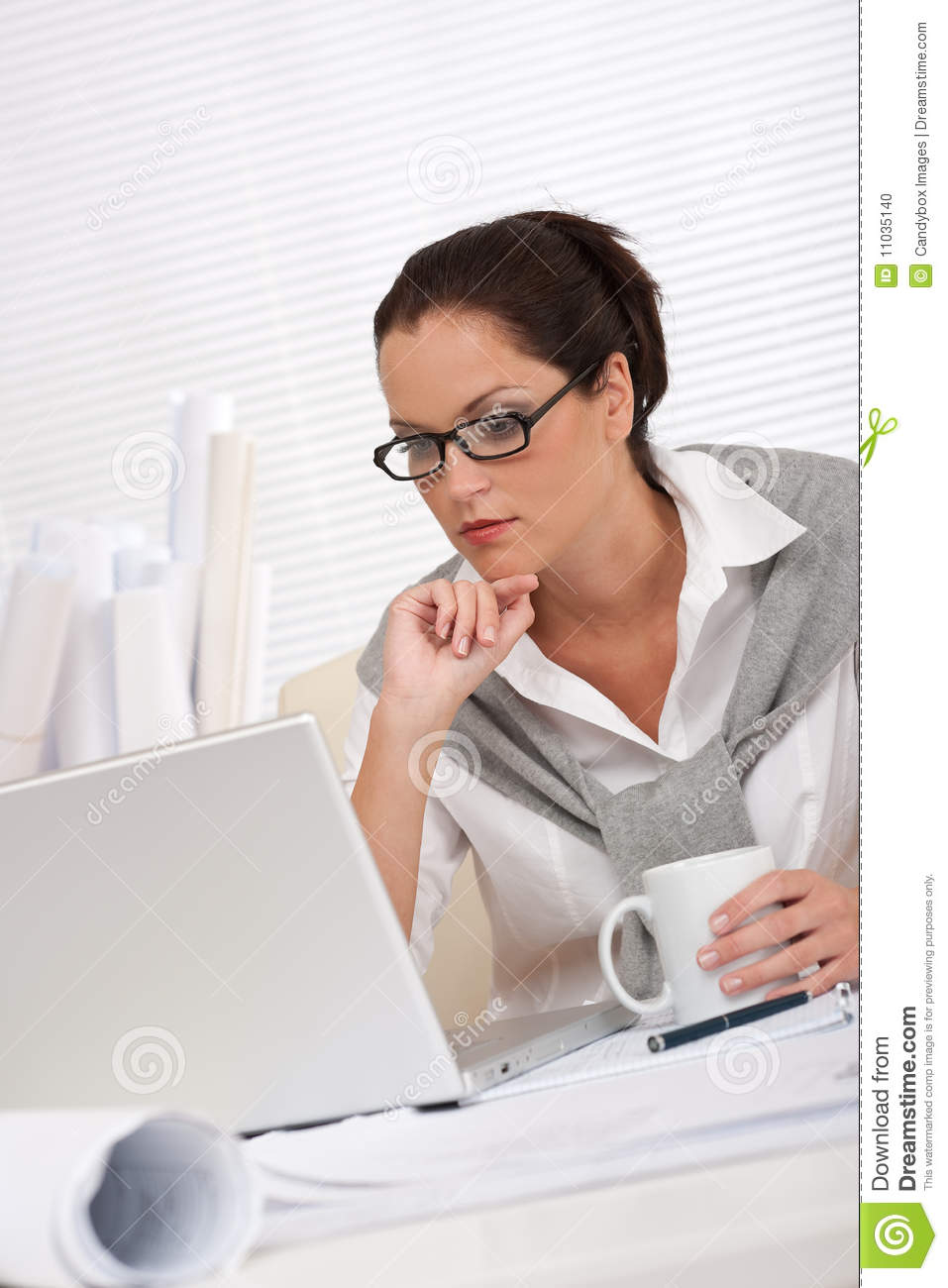 Successful architect business woman work at office stock for Architect at work