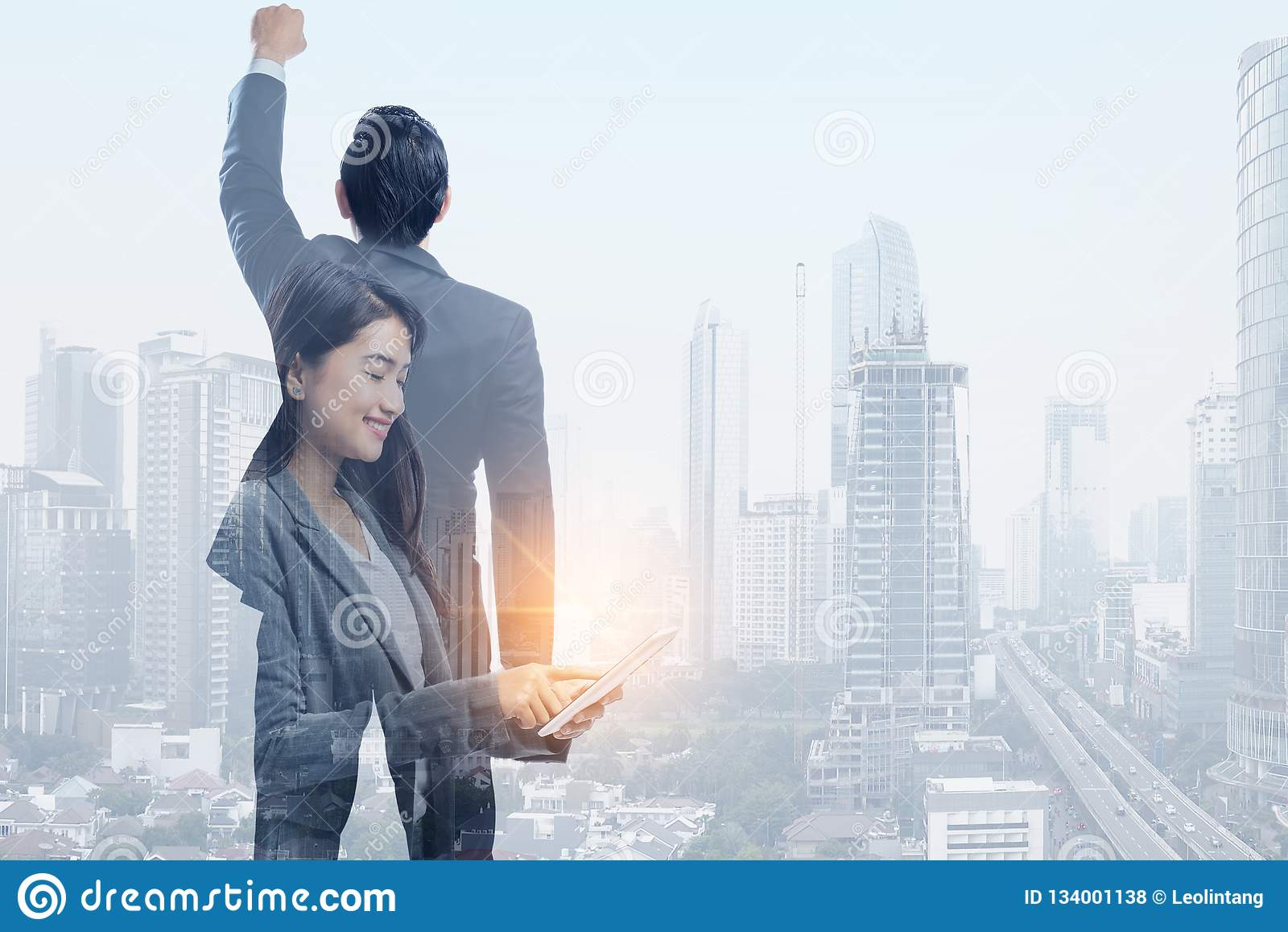 Successful asian business people and modern cityscapes