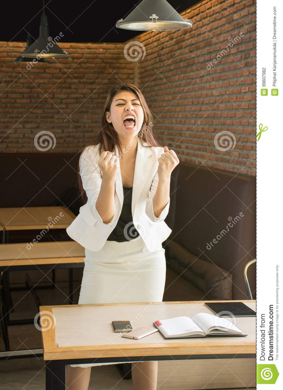 Successful Asian business woman with arms up