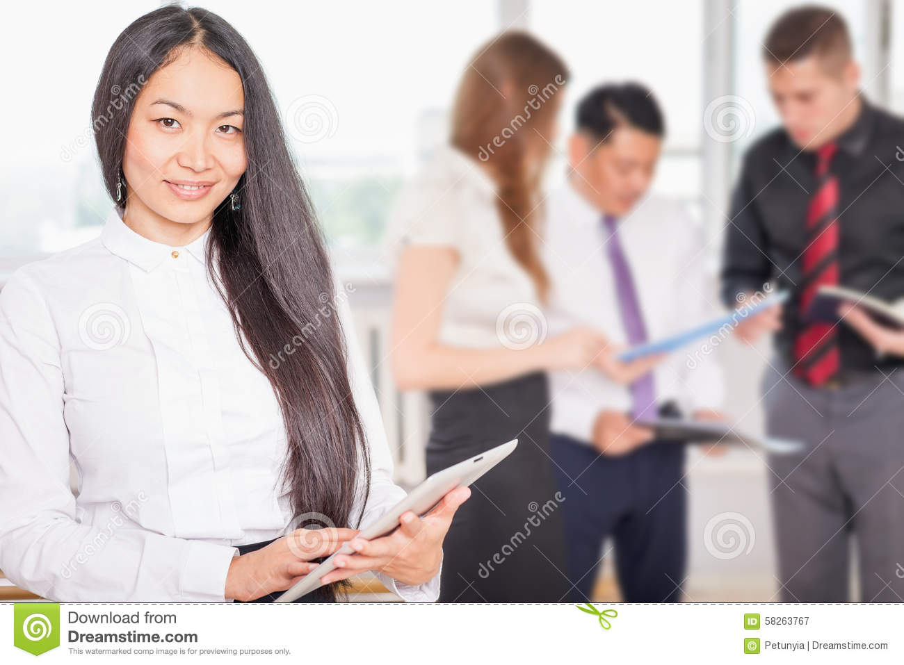 Successful Asian Business Woman Holding Tablet PC Stock ...