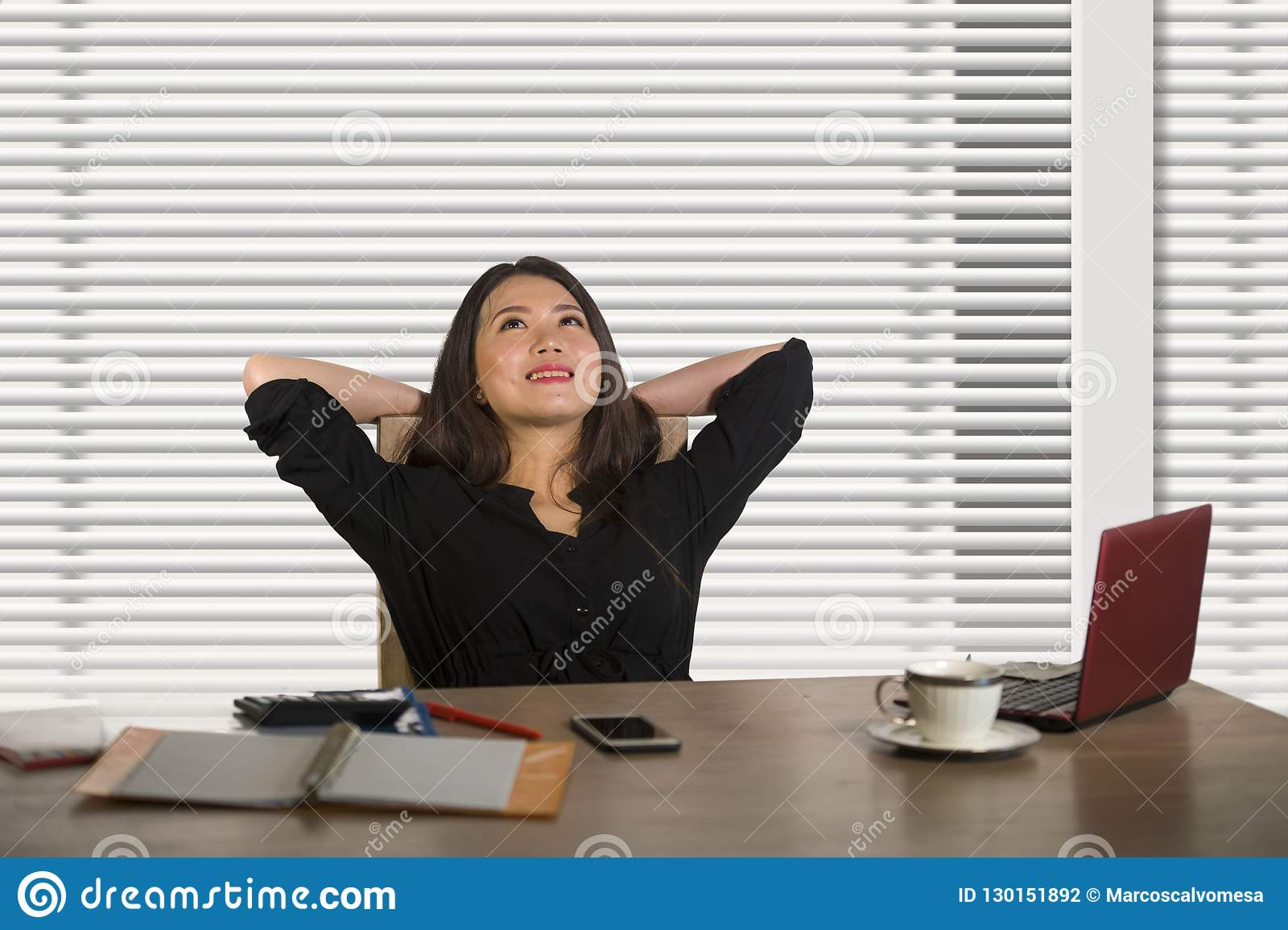 Successful Asian Korean business woman working confident at modern office computer desk in female businesswoman job smiling cheer