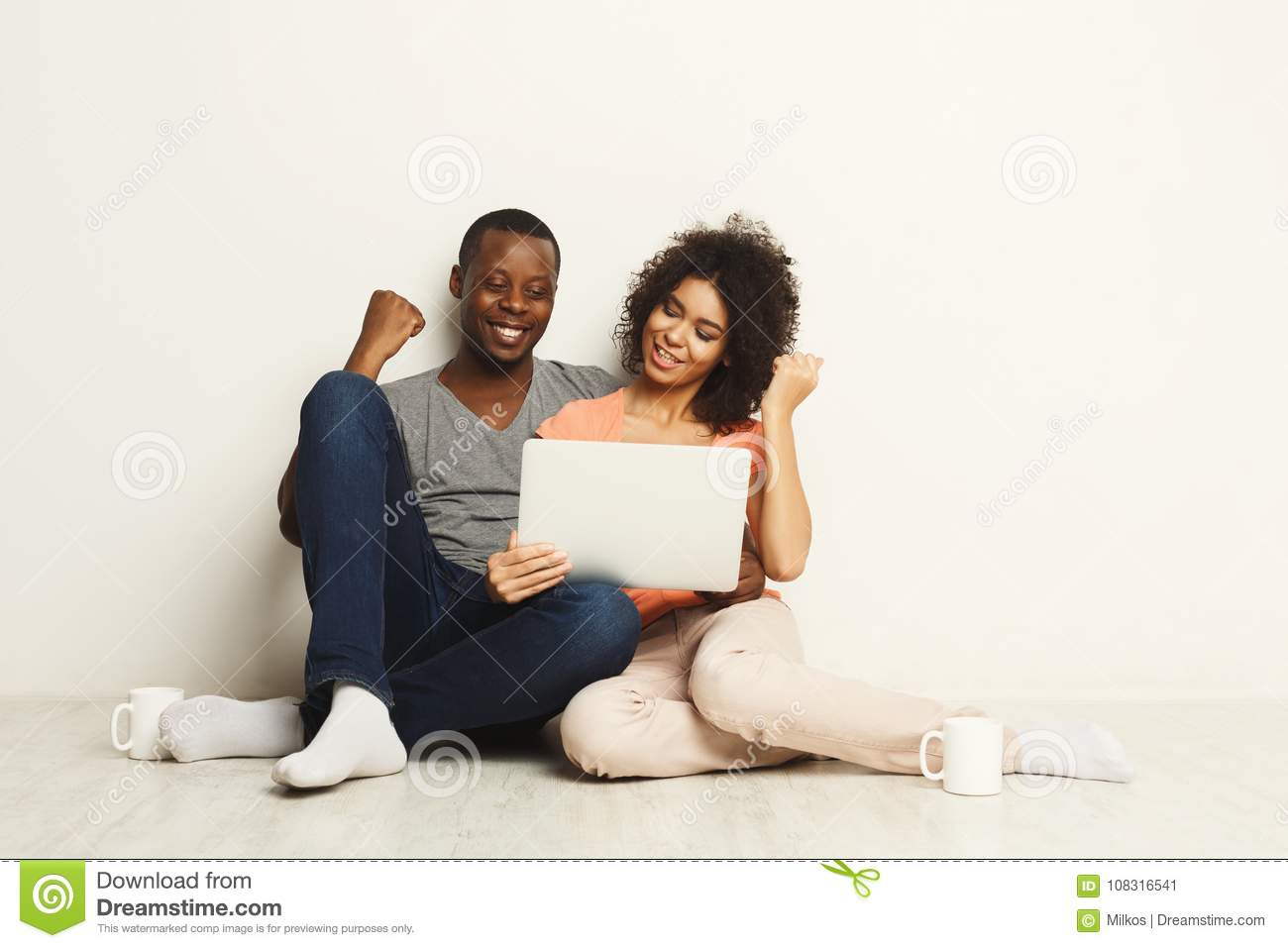 Successful black couple winning in online game