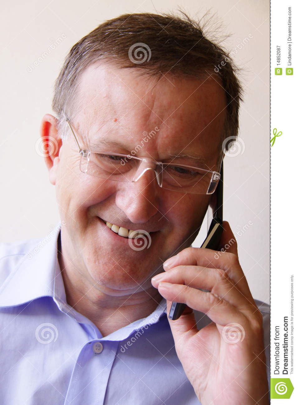 Successful business manager smiling on mobile