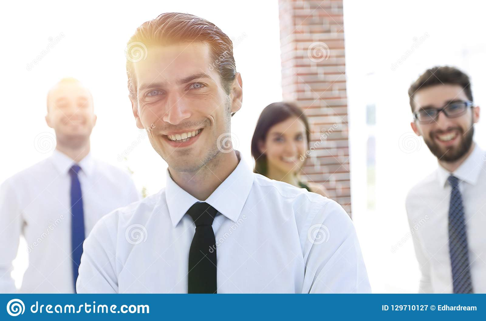 Portrait of a successful business person on the background of colleagues.