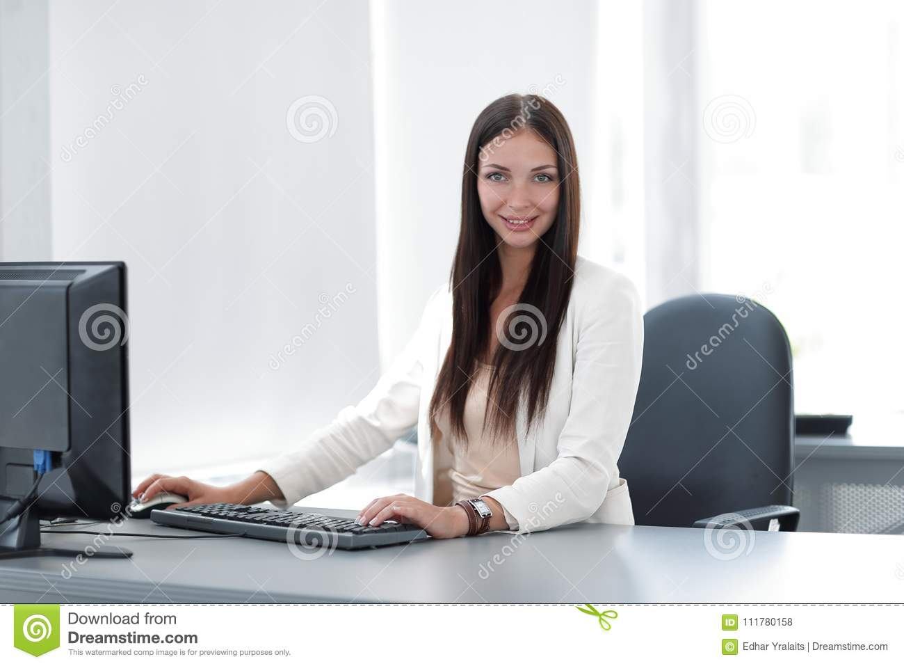 Successful business woman sitting at a Desk