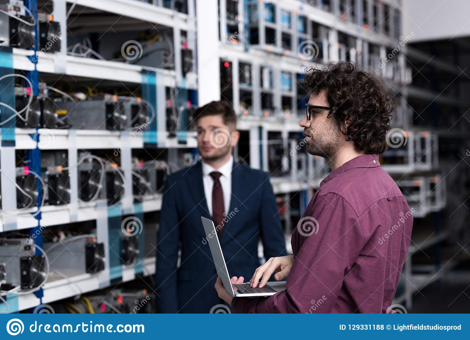 Successful businessman and computer engineer working together at bitcoin mining farm royalty free stock photos
