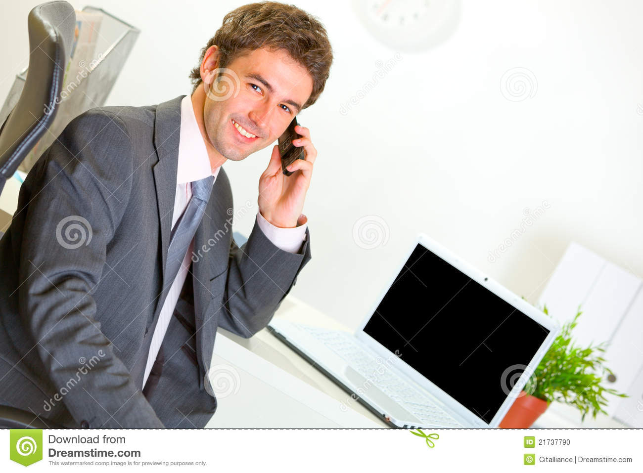 Successful Businessman In Office Making Phone Call Stock