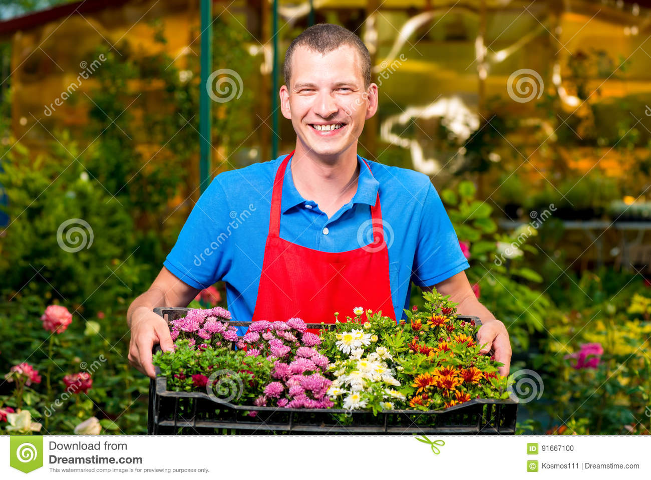 Successful businesswoman holding in her hands seedling flowers