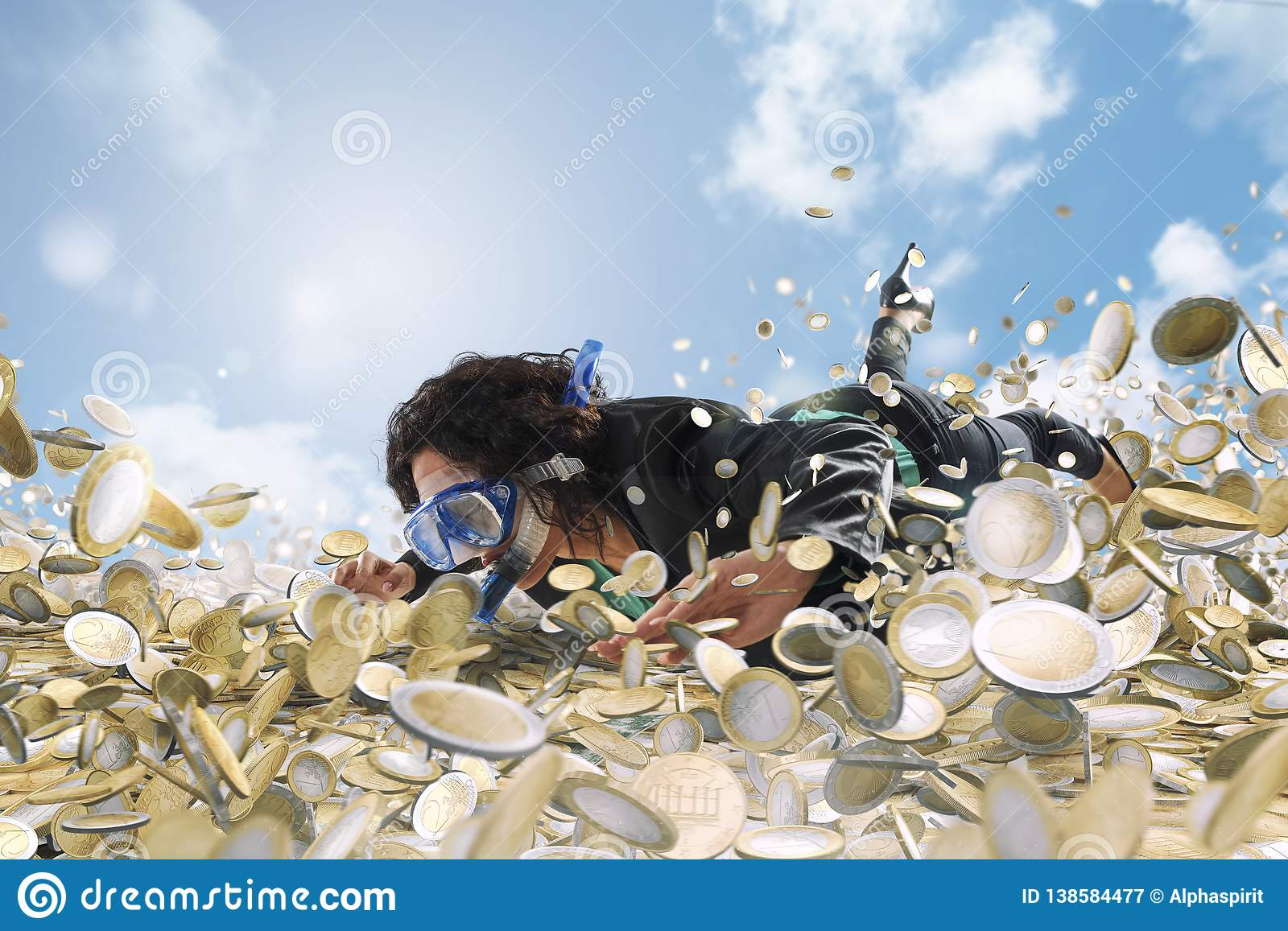 Businesswoman swims in a pool of money