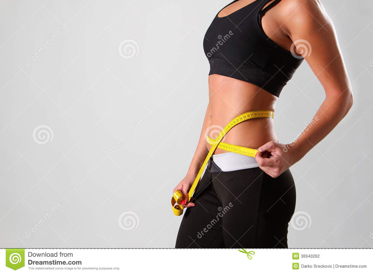 Successful diet,attractive young girl with measure tape.