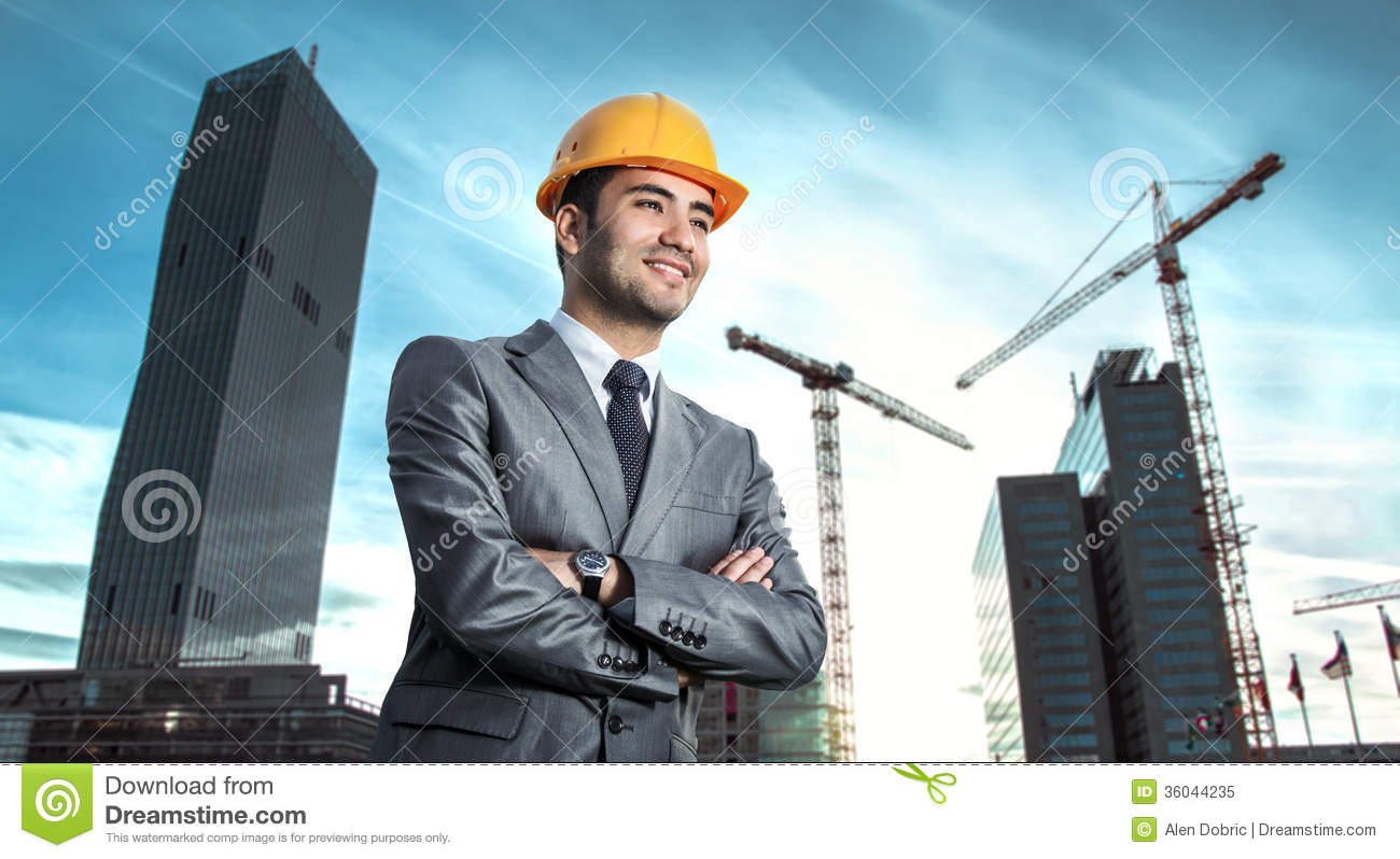 Successful engineer or architect, crane and building construction at