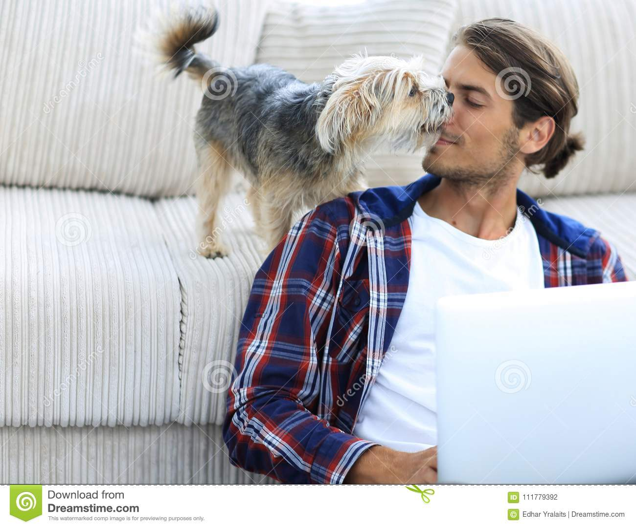 Successful guy and his favorite pet in a cozy living room.