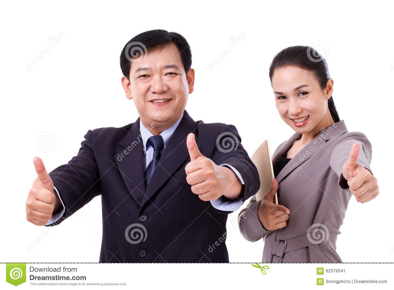 successful, happy, confident business people giving thumb up gesture to you