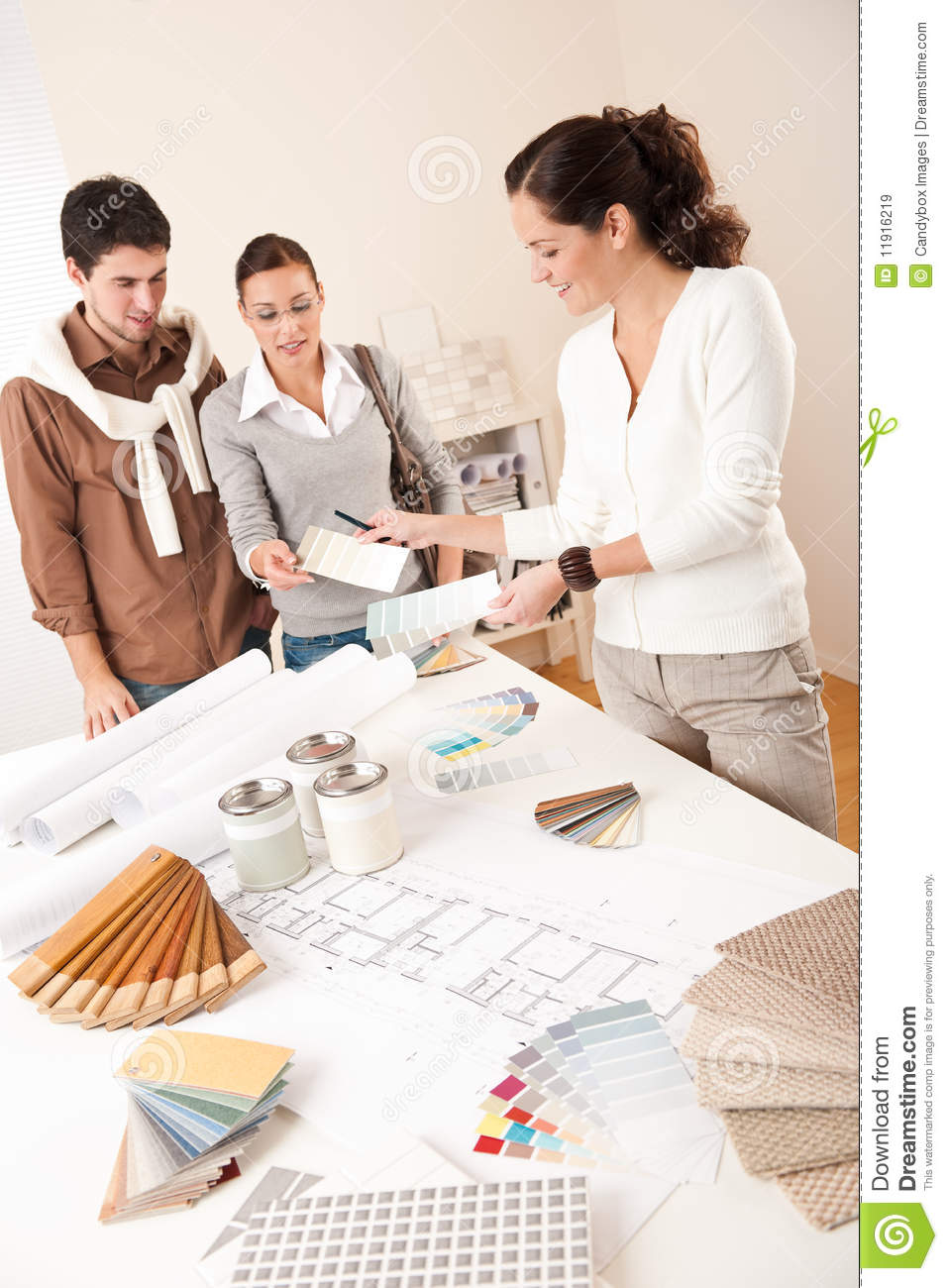 Successful interior designer woman with two client stock for Image of interior design