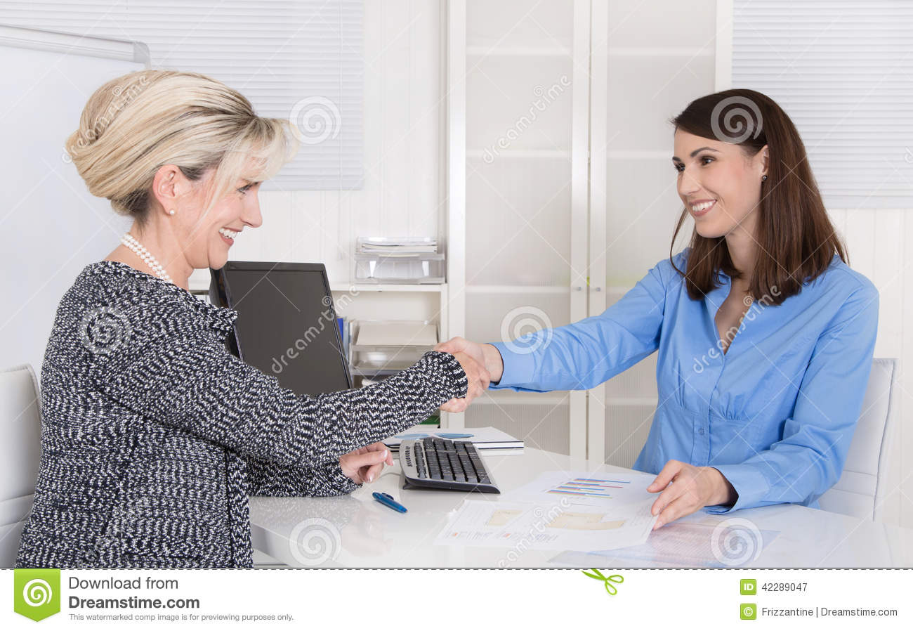successful w business team or handshake in a job interview successful w business team or handshake in a job interview